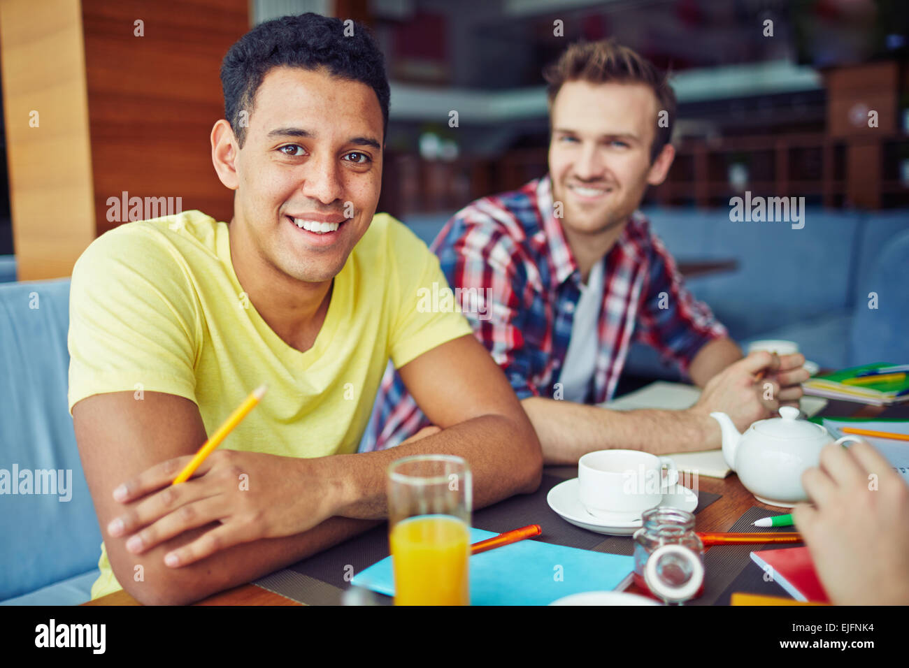 Two boys at breakfast sitting and looking at camera Stock Photo