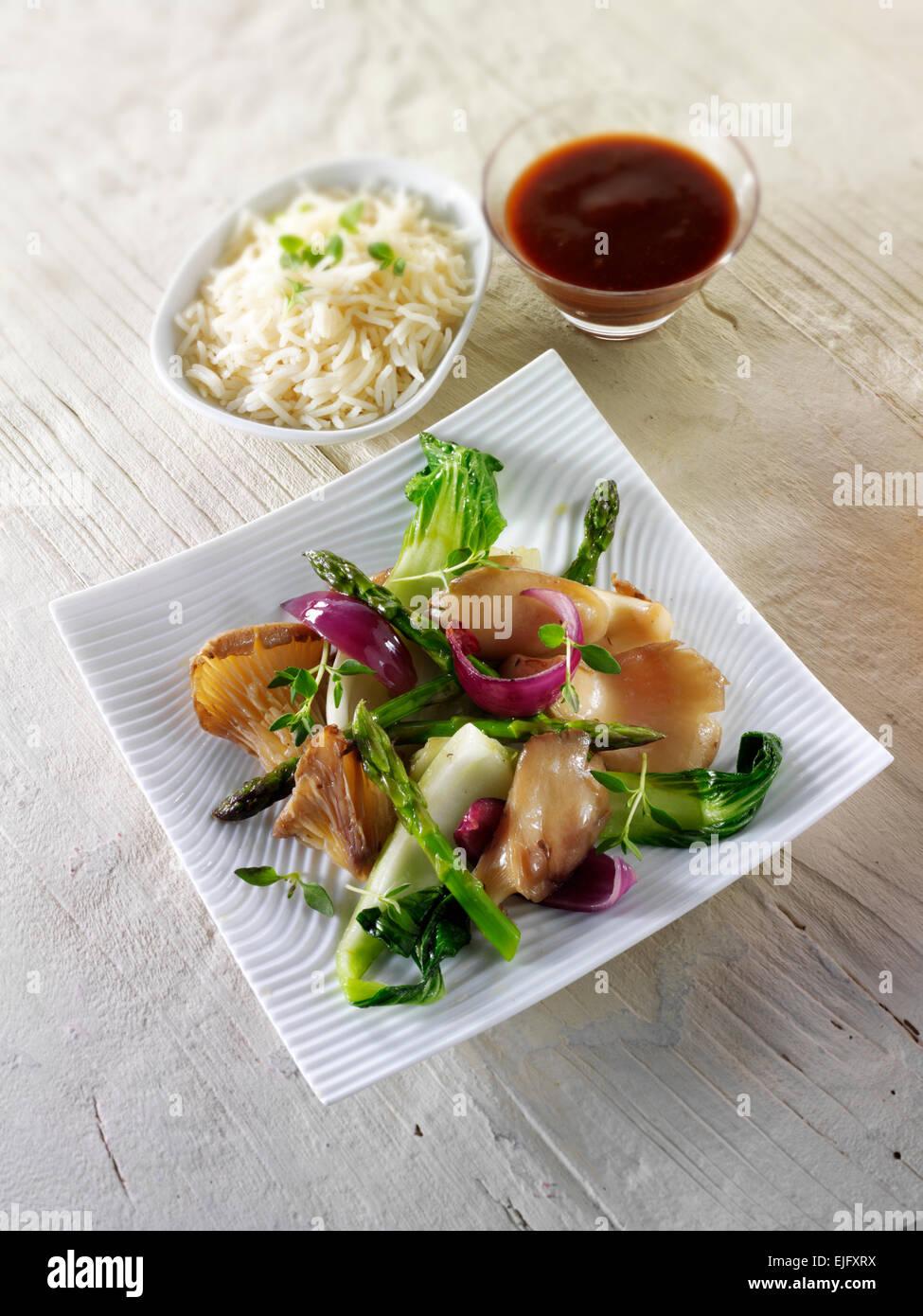 Oriental Chinese vegetarian stir fry of vegetables, and mushrooms Stock Photo