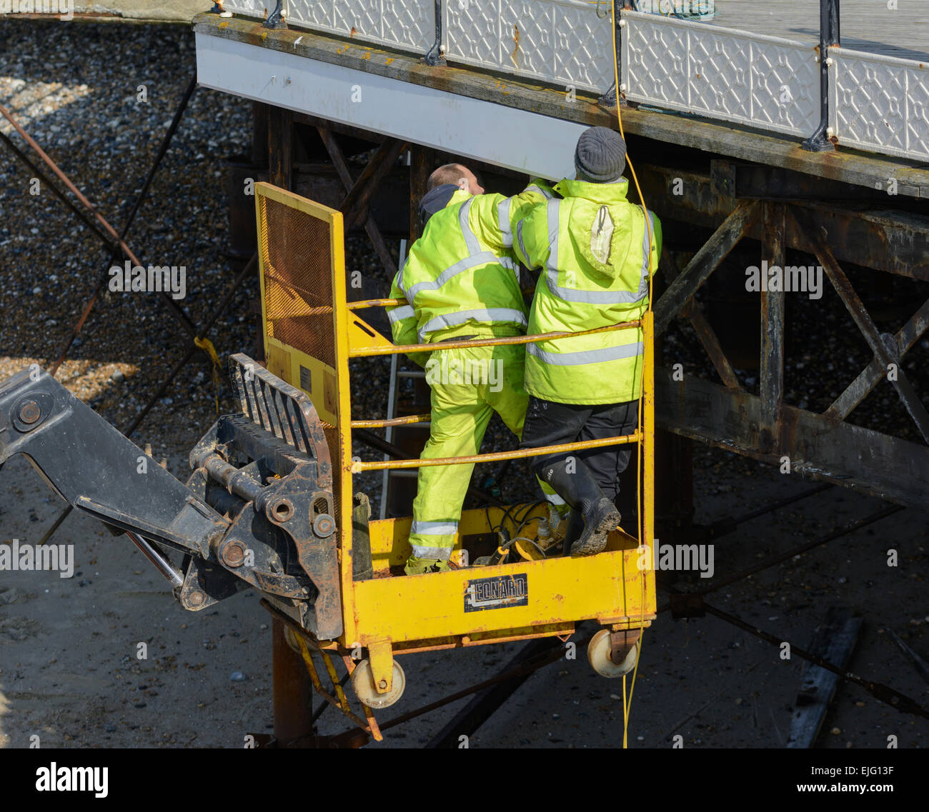 2 workmen in a cherry picker. - Stock Image
