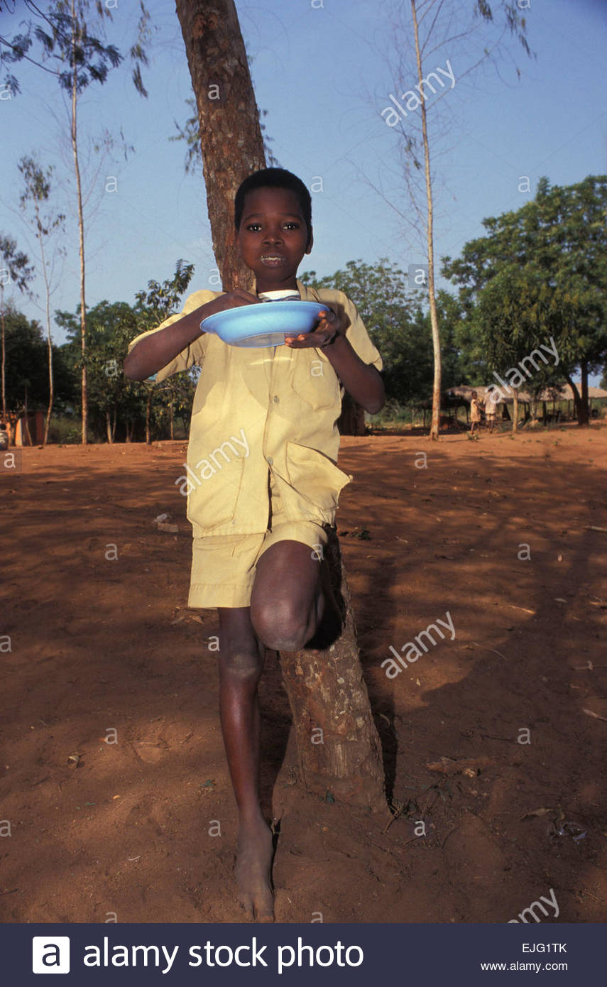 Schoolboy during lunch time, Benin - Stock Image