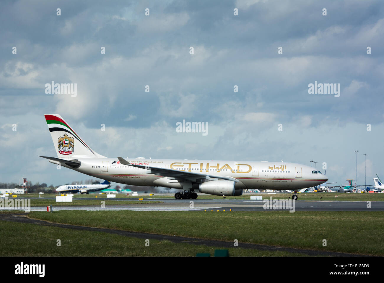 Etihad Airbus 330 commercial plane on runway at Dublin airport Ireland - Stock Image