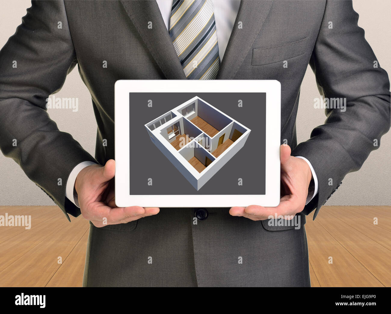 Man holding tablet with three-dimensional model in screen - Stock Image