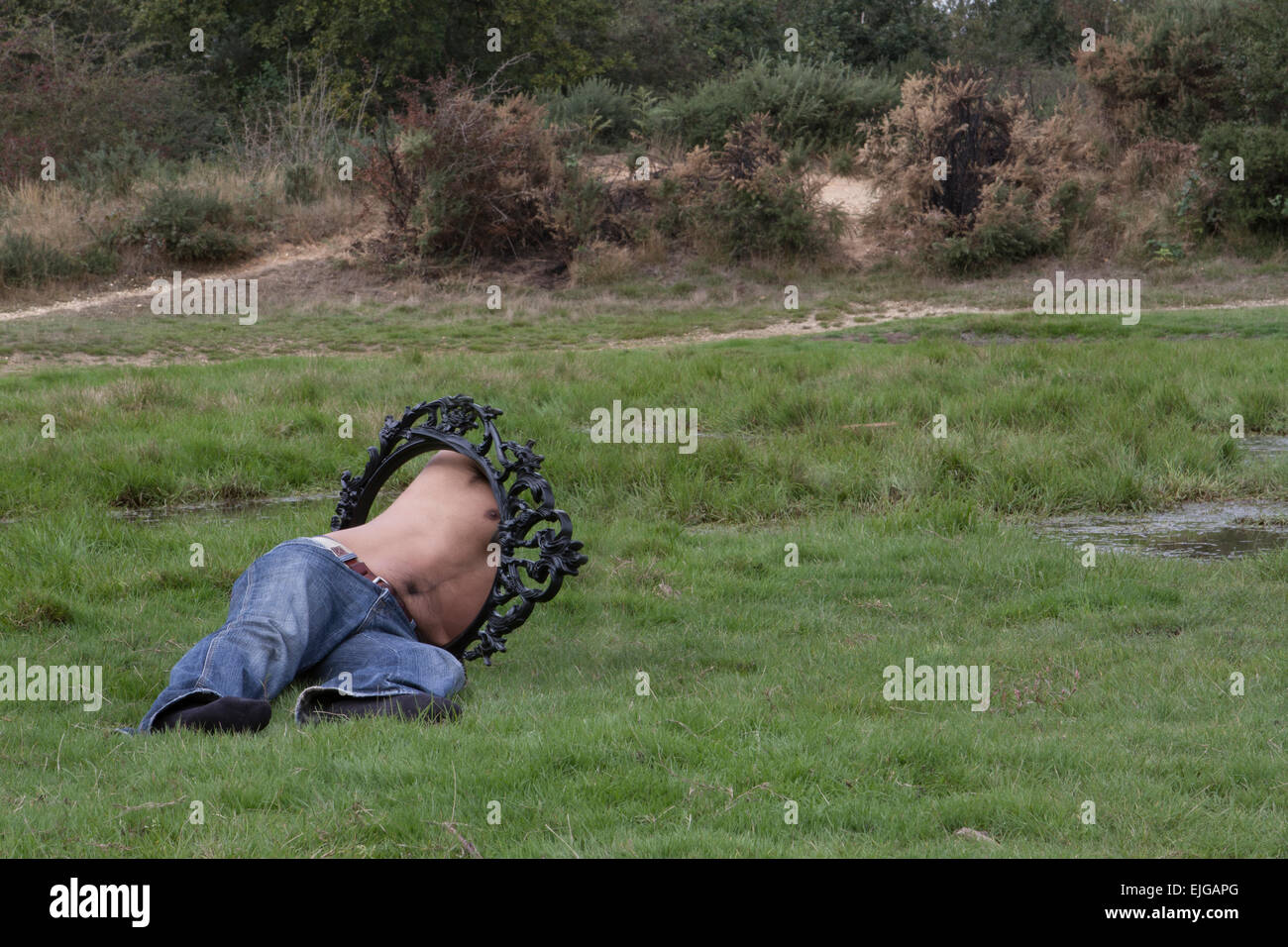 the scape, the scaping man, man on the forest, man in the frame, hombre en un cuadro, el escape, hombre en el escape, - Stock Image