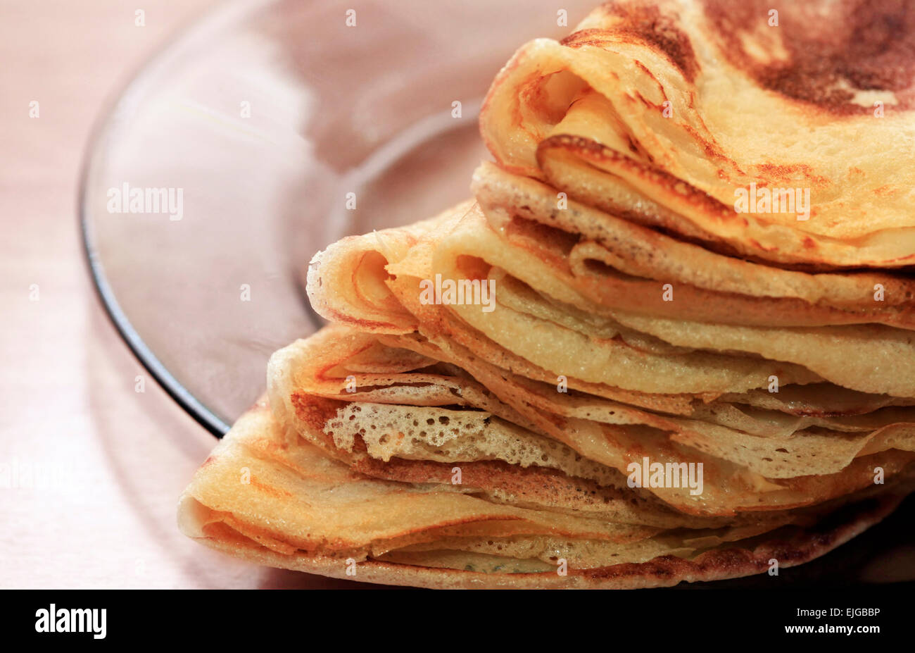 Close up of a pancakes pile with copy-space on the top - Stock Image