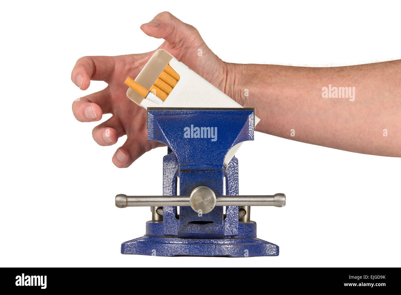 Hand grabbing pack of cigarettes trapped in a vice grip.  Concepts could include vice in a vise, dealing with addiction, - Stock Image