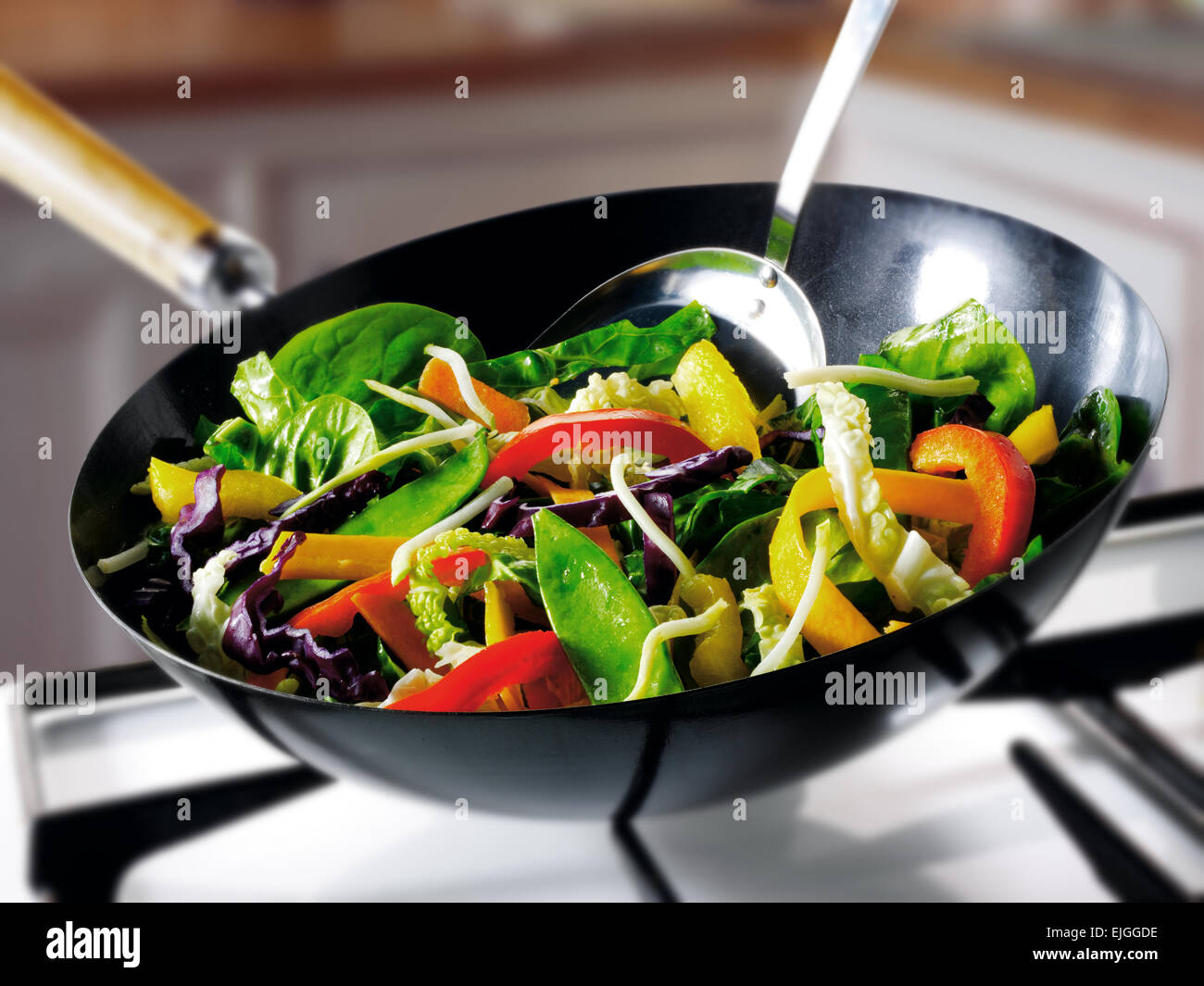 Stir fry vegetables being cooked in a wok - Stock Image