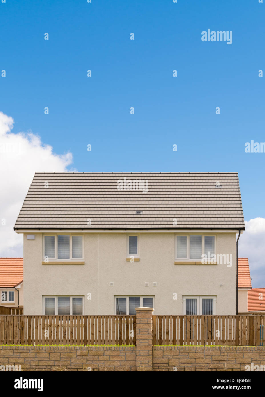 Detached new build family home with blue sky copy space - Scotland, UK - Stock Image