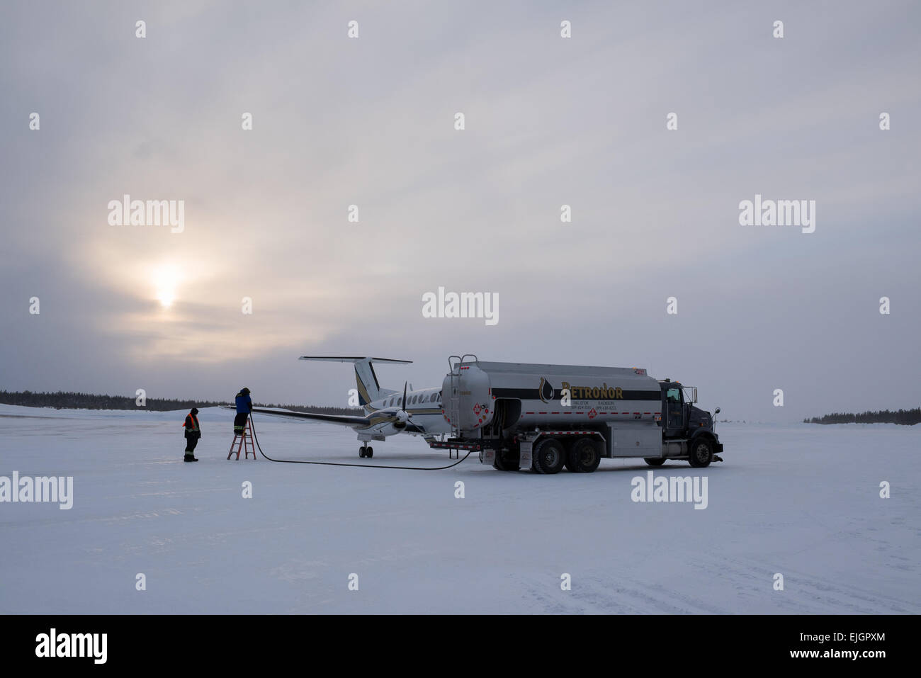 Small twin engine plane refueling Northern James Bay Quebec - Stock Image