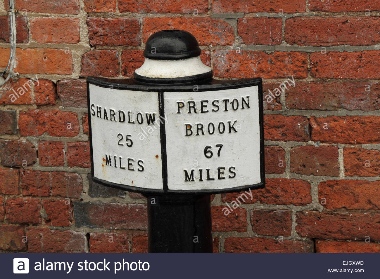 Milepost on the Trent and Mersey Canal at Fradley Junction, Staffordshire, England, UK - Stock Image