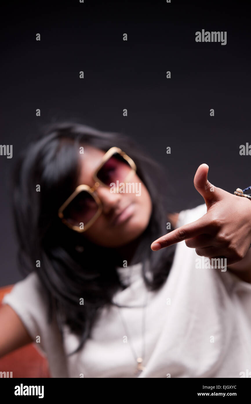 fly girl playing hip hop star with a pair of big sunglasses - Stock Image