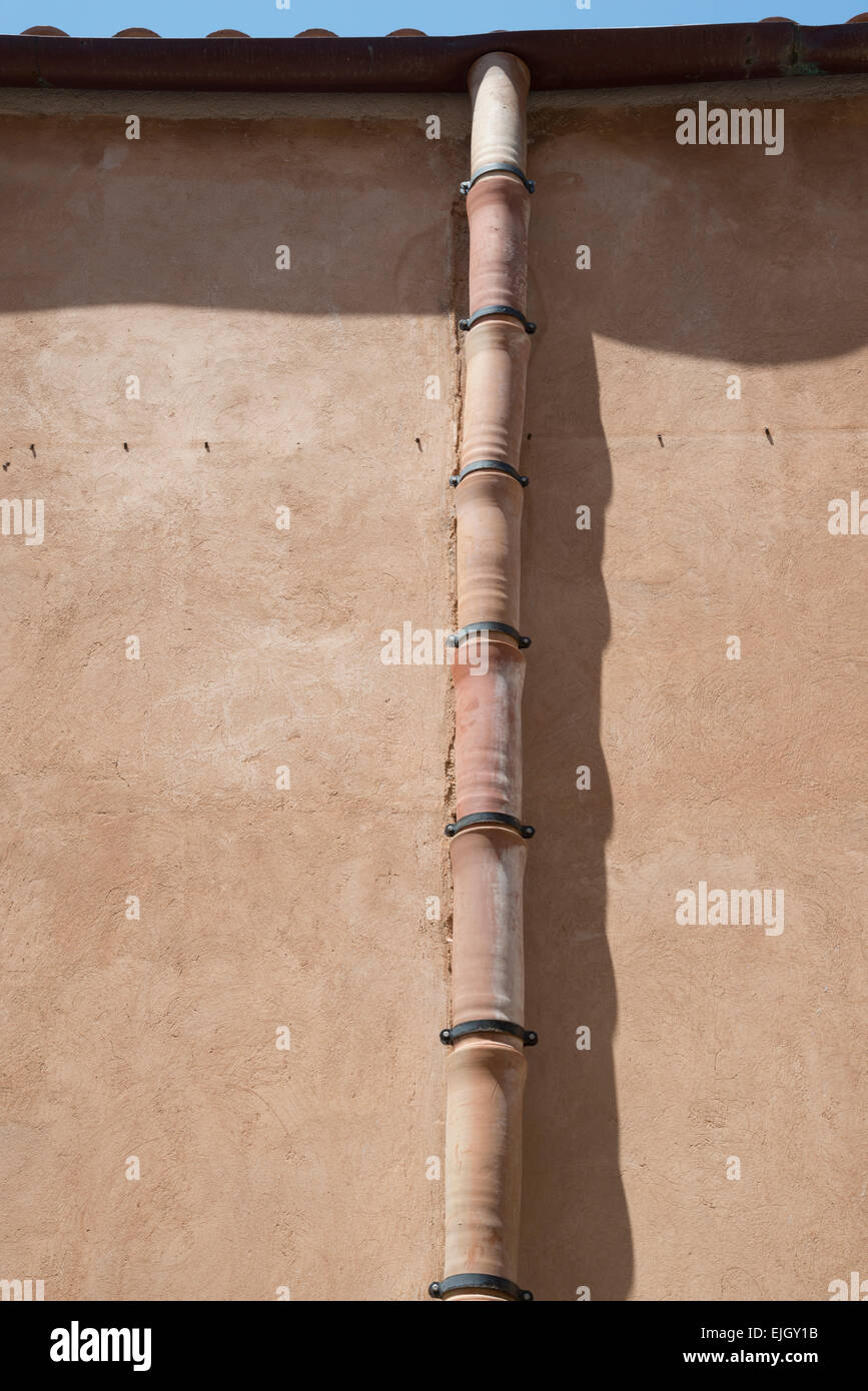 Terracotta drainpipe on a medieval building in Cefalu Sicily - Stock Image