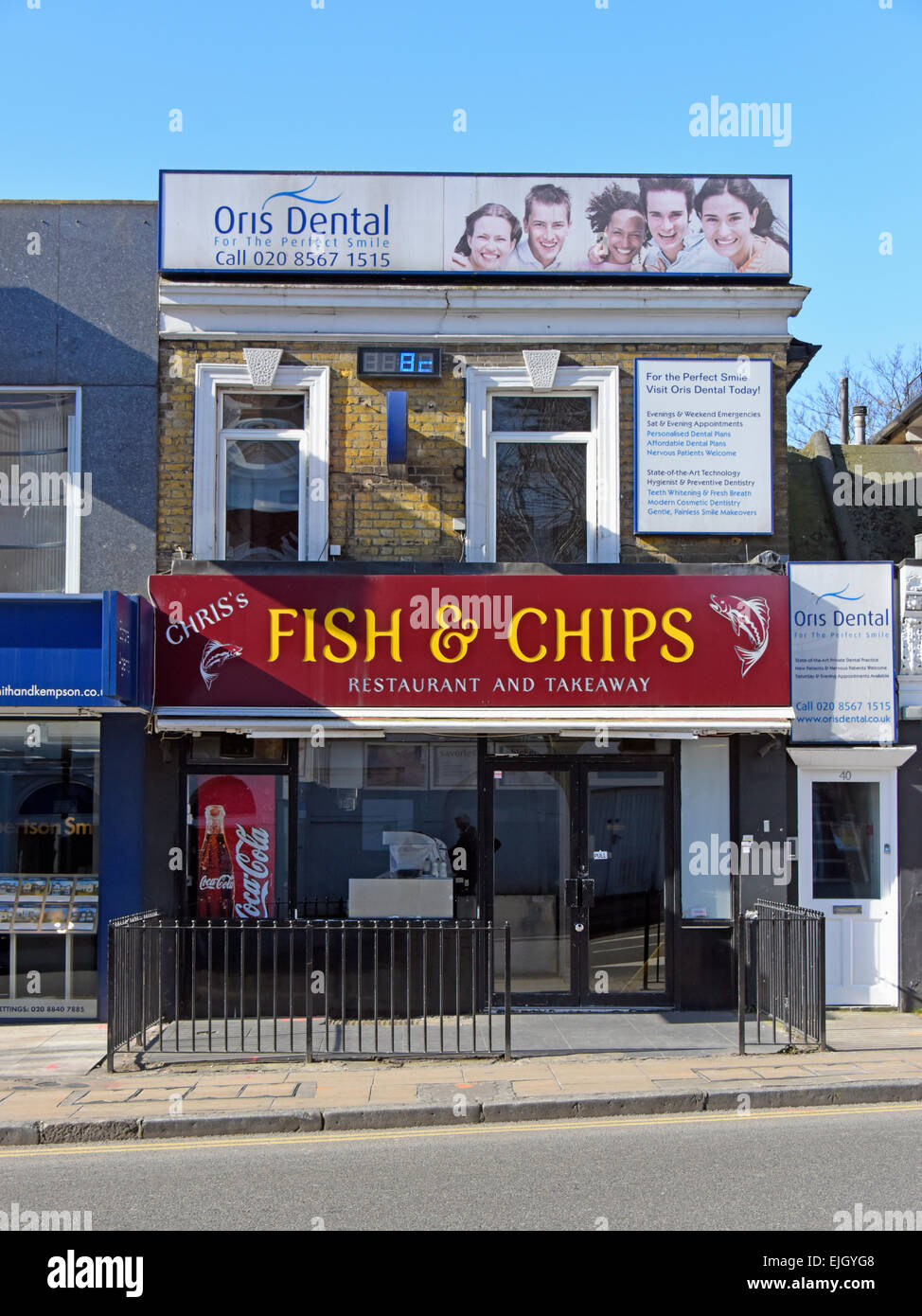 Chris's Fish & Chips and Oris Dental. High Street, Ealing, London, England, United Kingdom, Europe. Stock Photo