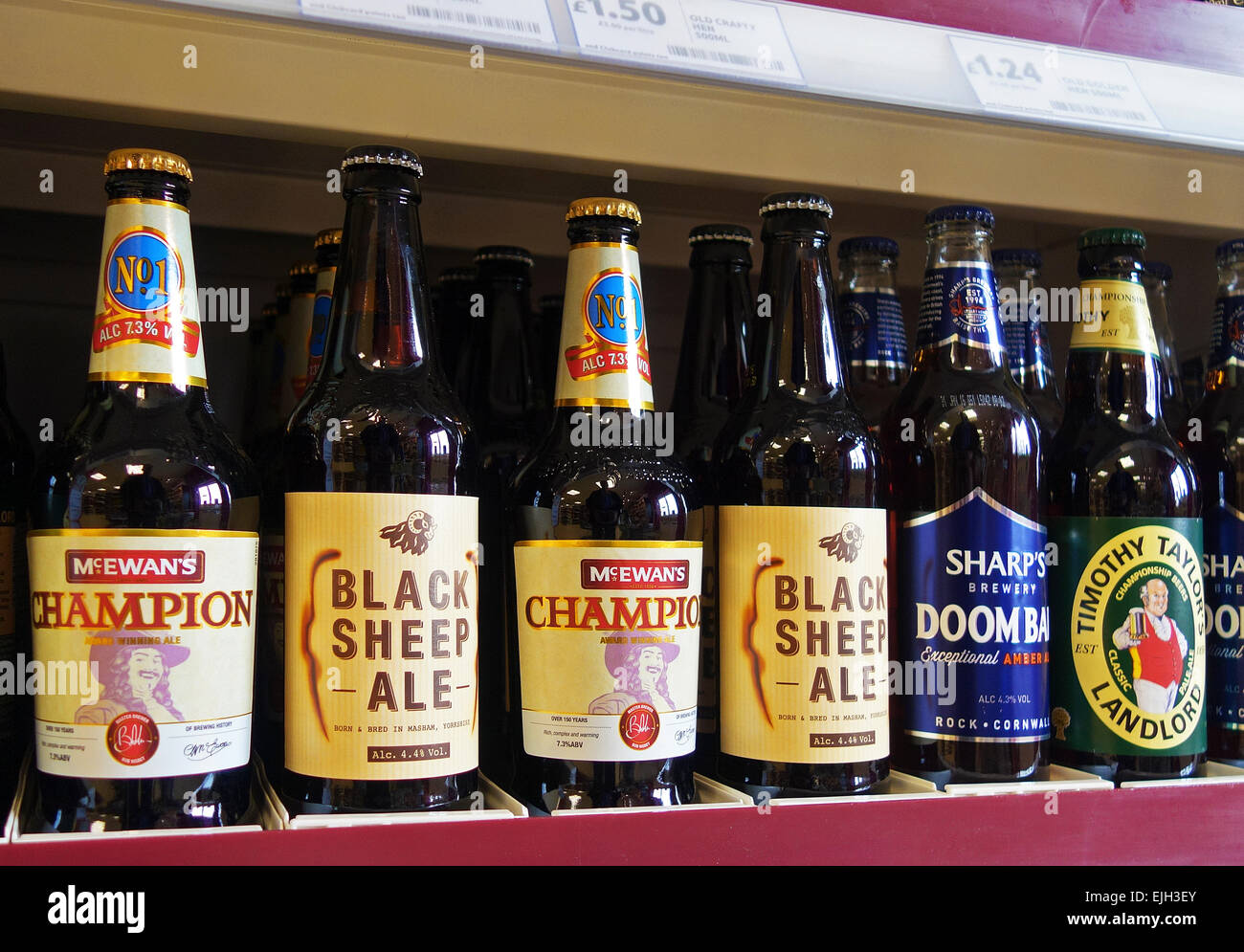 Bottles of Premium Beers on a supermarket shelf in the uk - Stock Image