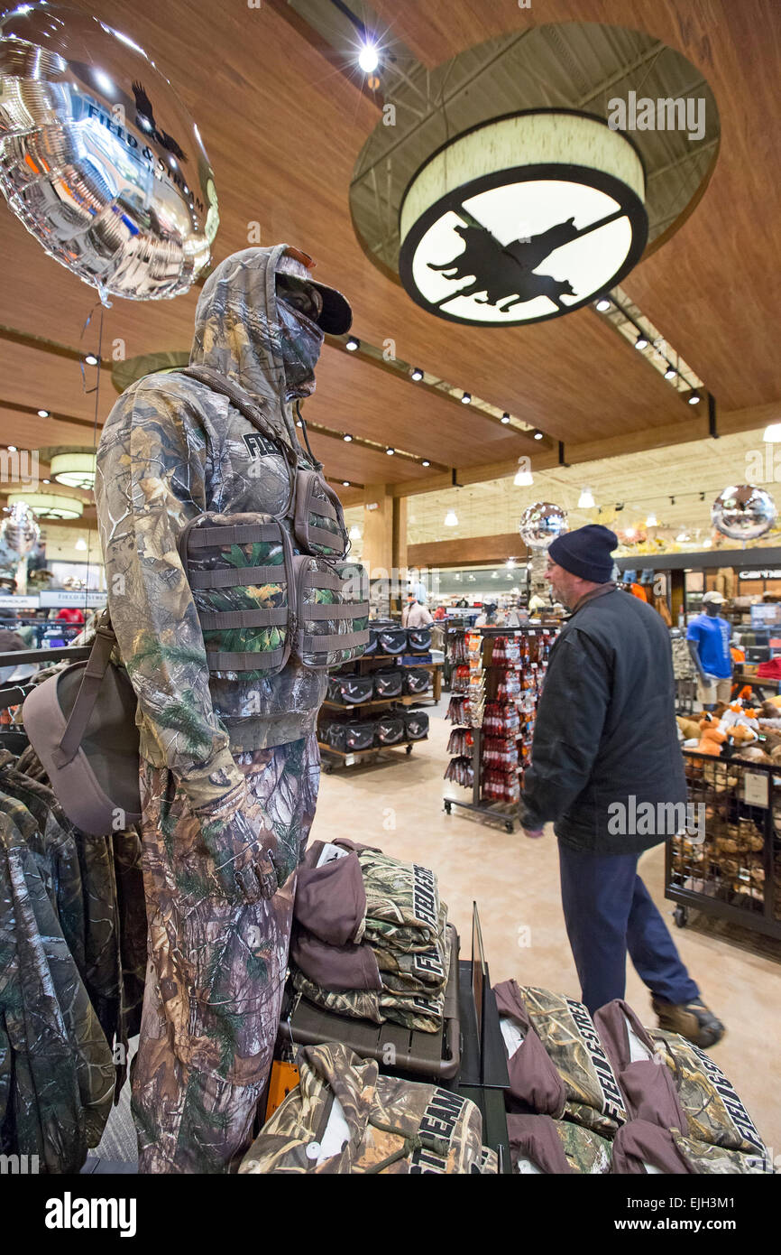 Troy, Michigan - A mannequin dressed in camouflage at the Field & Steam outdoors store. - Stock Image