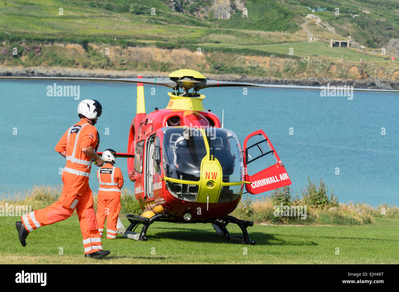 Eurocopter EC135 of Cornwall Air Ambulance about to take off from St Ives, Cornwall, U.K. - Stock Image