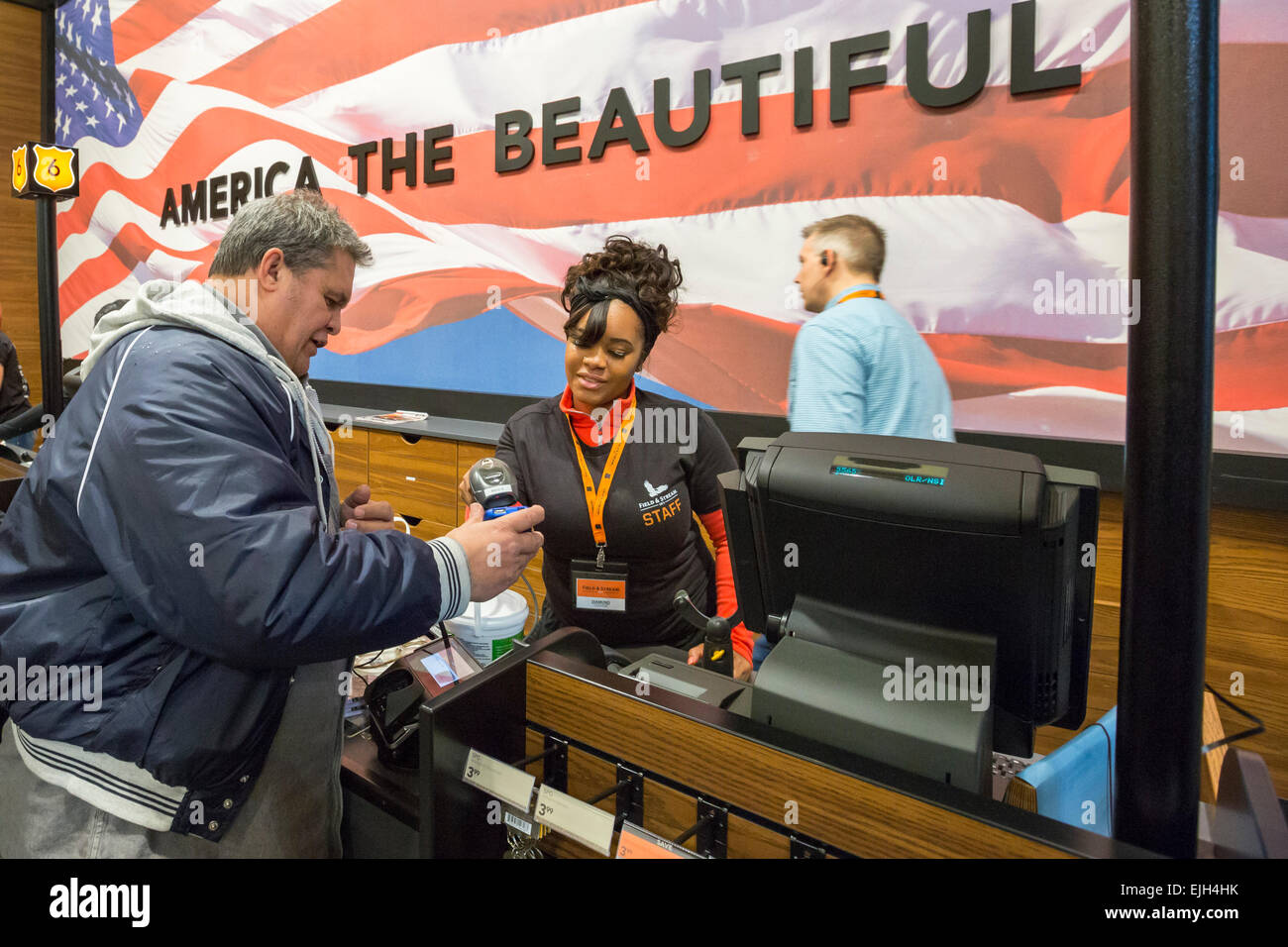 Troy, Michigan - A checkout clerk at the Field & Steam outdoors store. - Stock Image