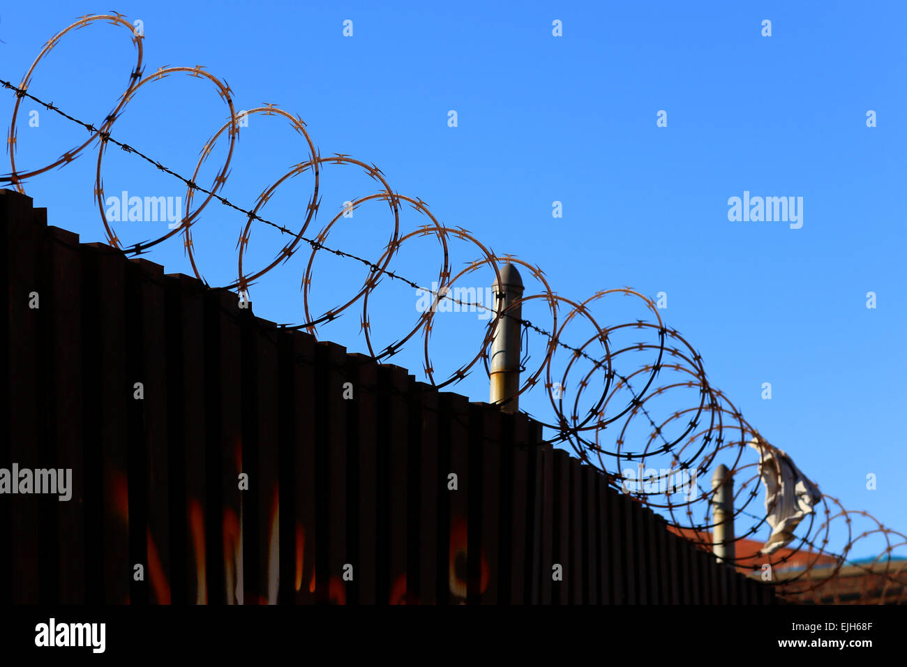 Razor Wire On Top Of Wire Fence Stock Photos & Razor Wire On Top Of ...
