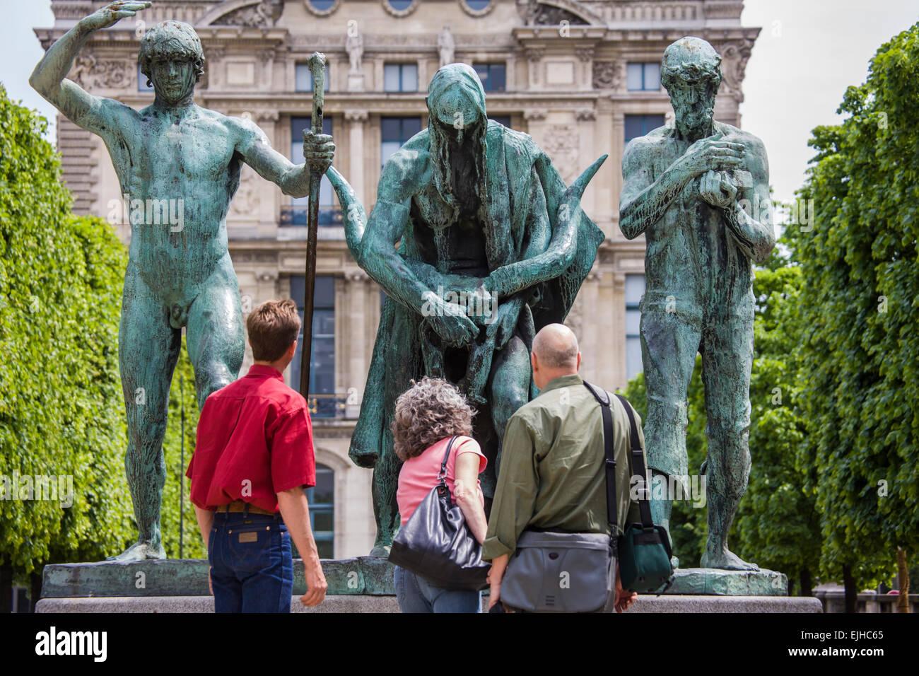 Visitors looking at statues on the Terrasse du Bord de L'eau, Paris, France Stock Photo