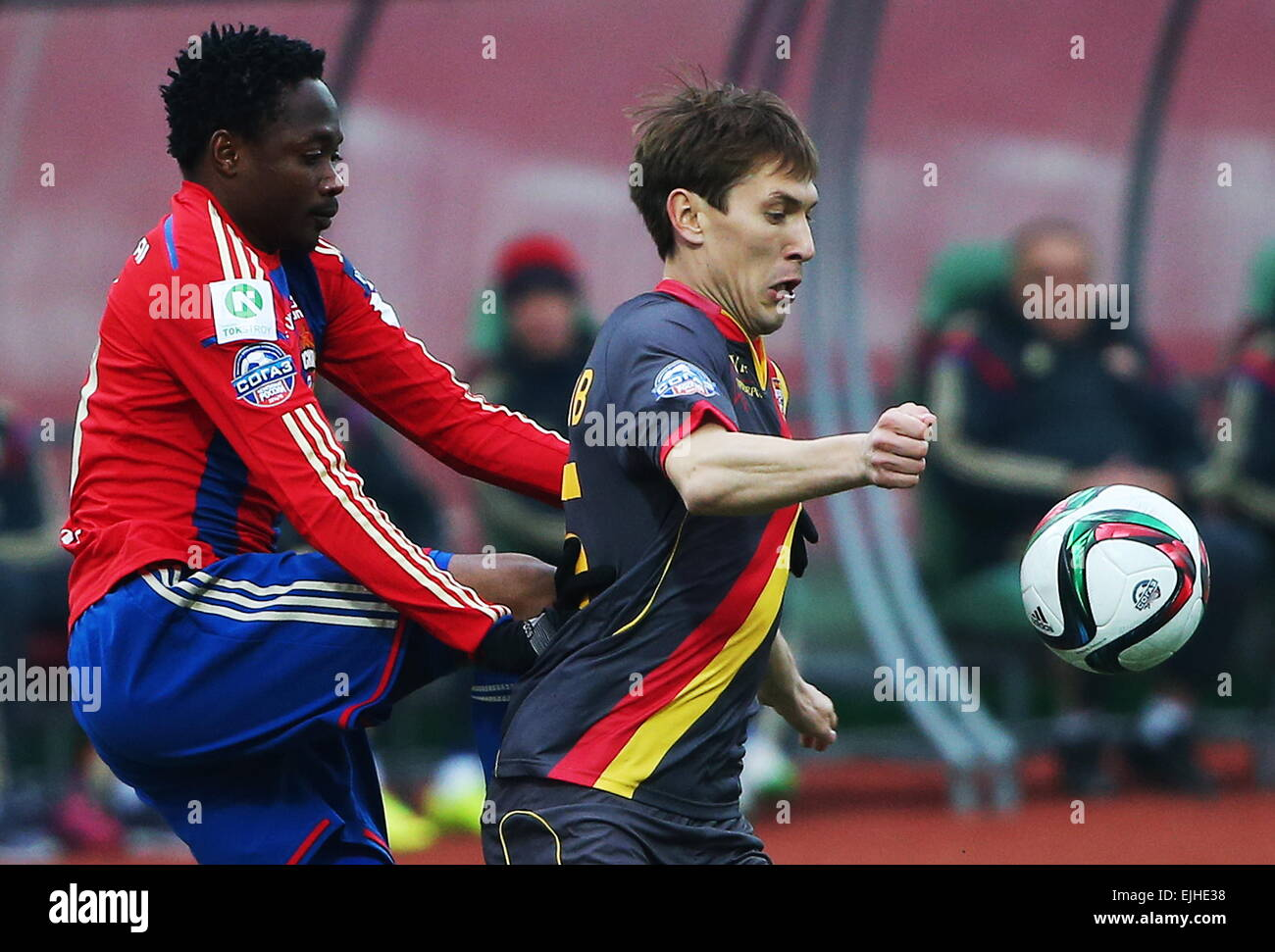 Moscow, Russia. 21st Mar, 2015. CSKA's Ahmed Musa (L) and Arsenal's Aleksander Kryuchkov fight for the ball - Stock Image