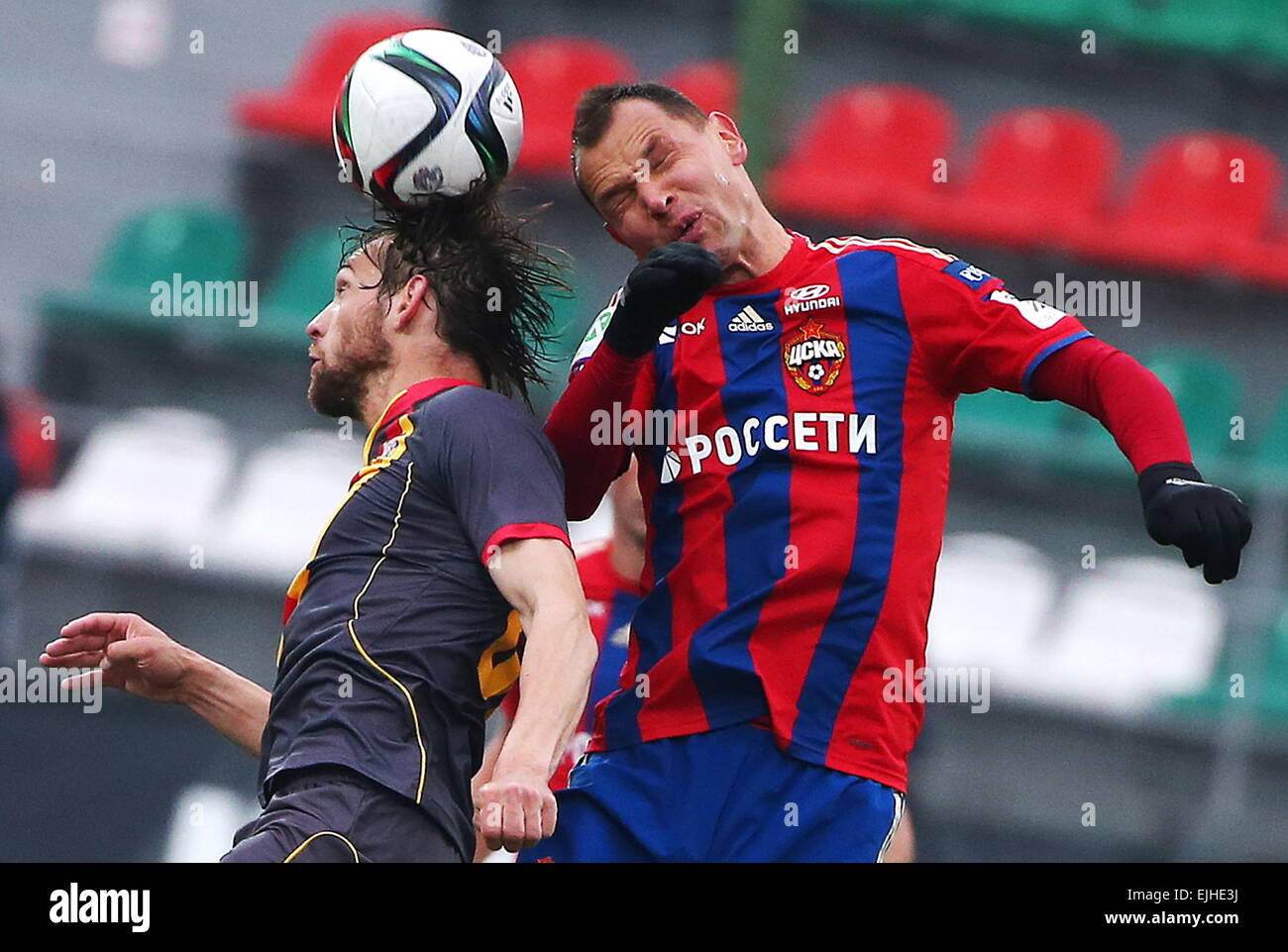 Moscow, Russia. 21st Mar, 2015. Arsenal's Leonid Boyev (L) and CSKA's Sergei Ignashevich fight for the ball - Stock Image