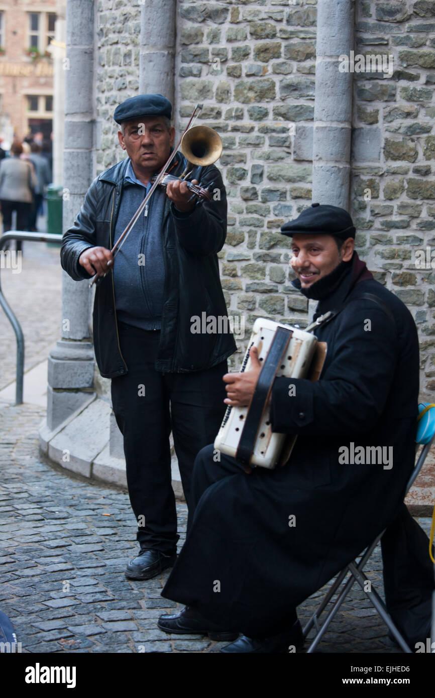 Immigrant street musicians, Bruges, Belgium - Stock Image