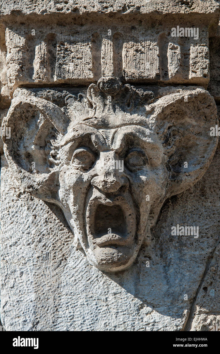 Stone carving, head with huge ears and wide open mouth, Munich, Bavaria, Germany - Stock Image