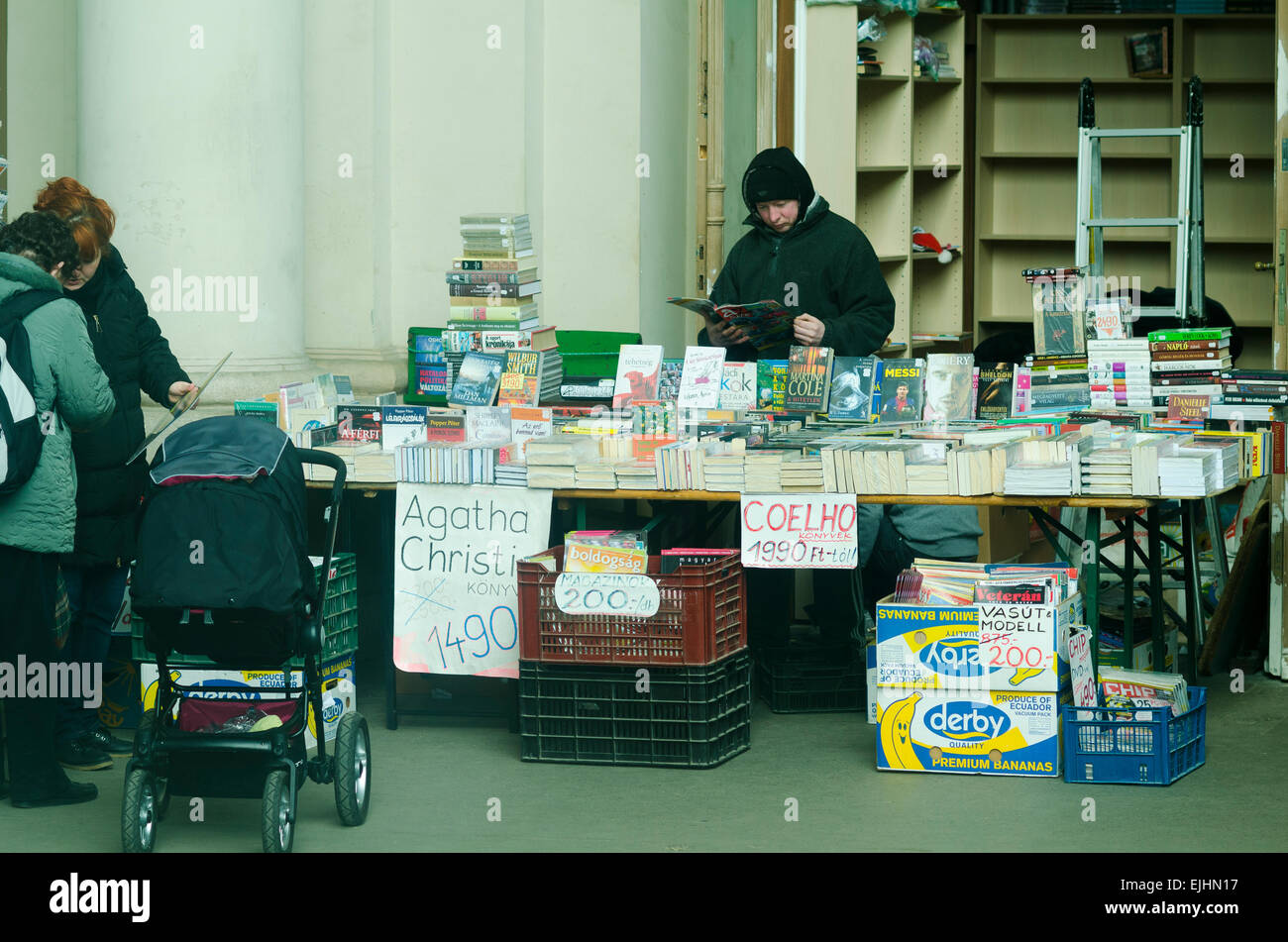 Second hand book seller at Budapest train station - Stock Image