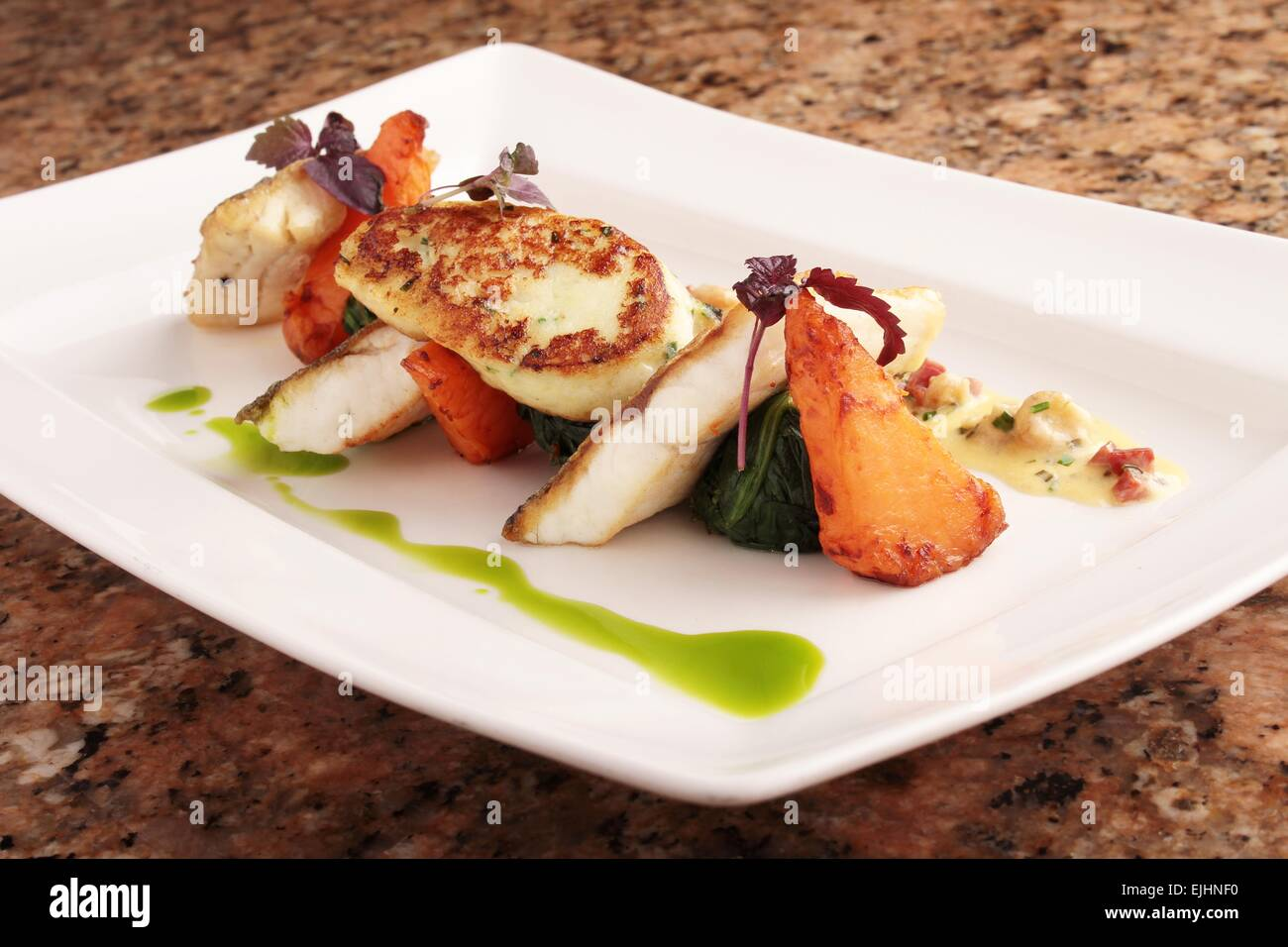 pan fried sea bass plated dinner meal & pan fried sea bass plated dinner meal Stock Photo: 80295348 - Alamy