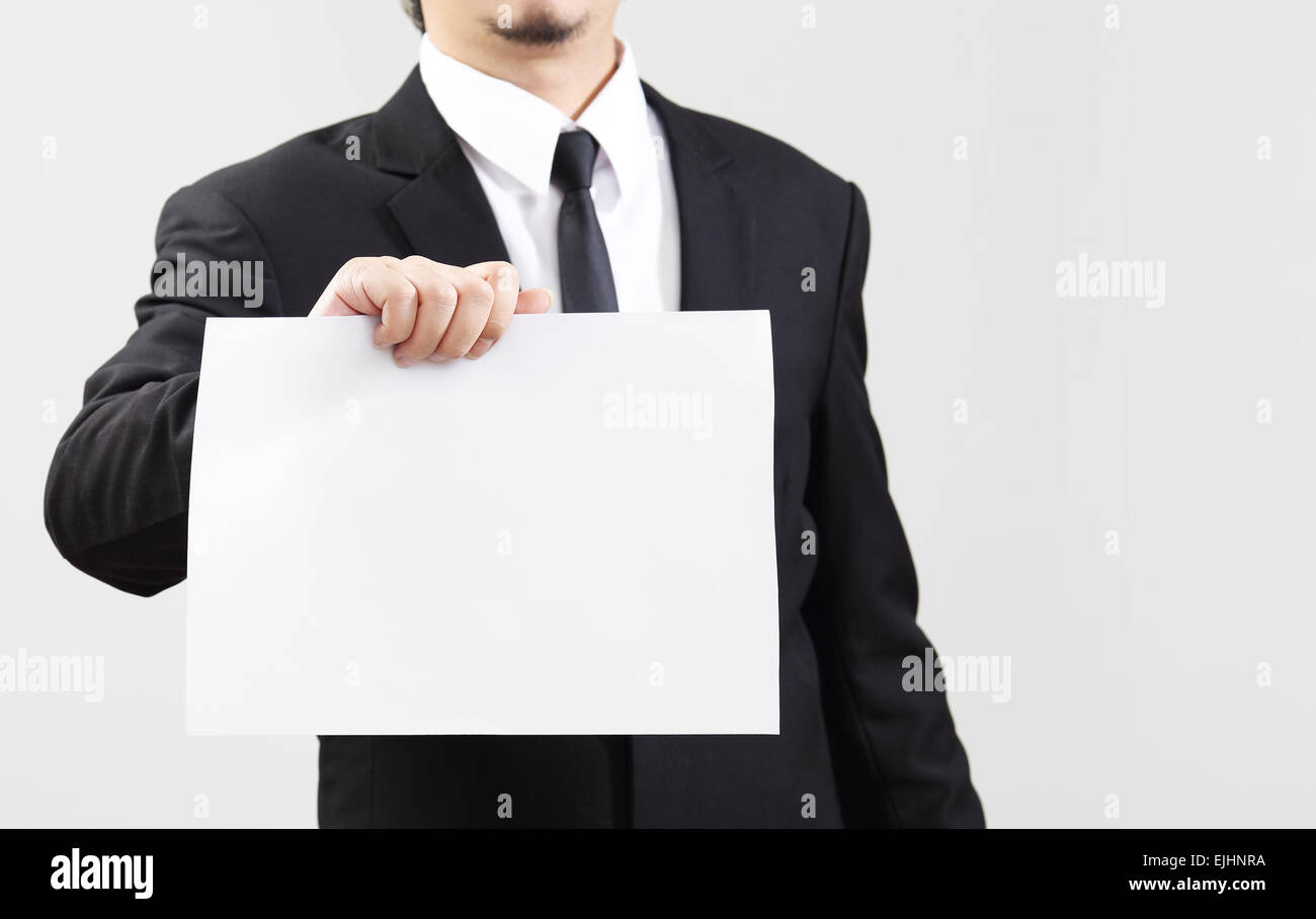 Businessman acting show paper for something communicate - Stock Image