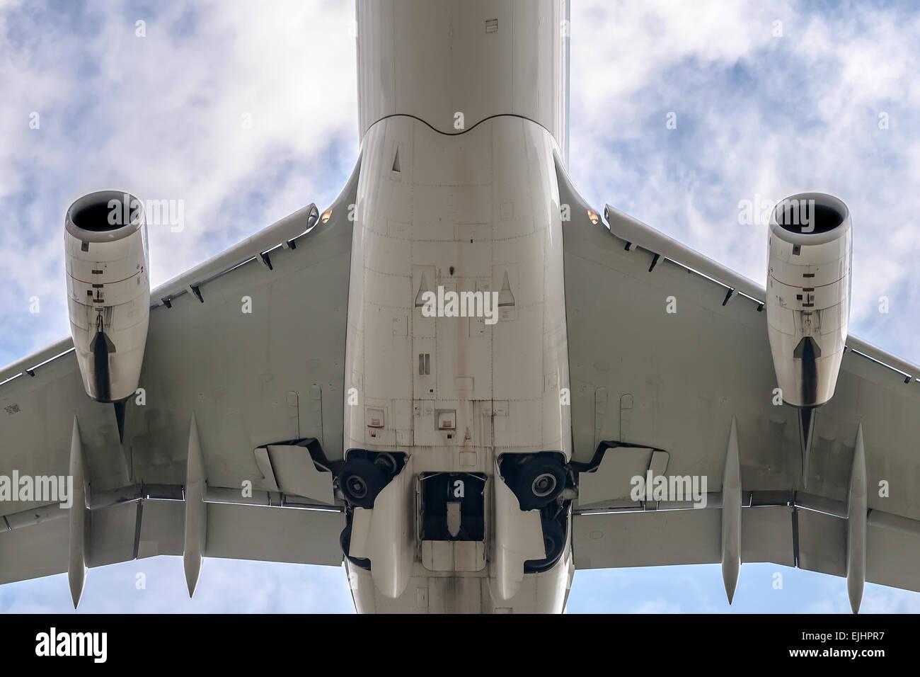 under a big jet plane taking off - Stock Image