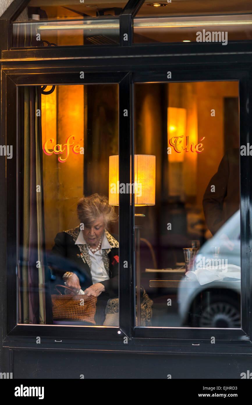 Lady in tea room window, Paris, France - Stock Image