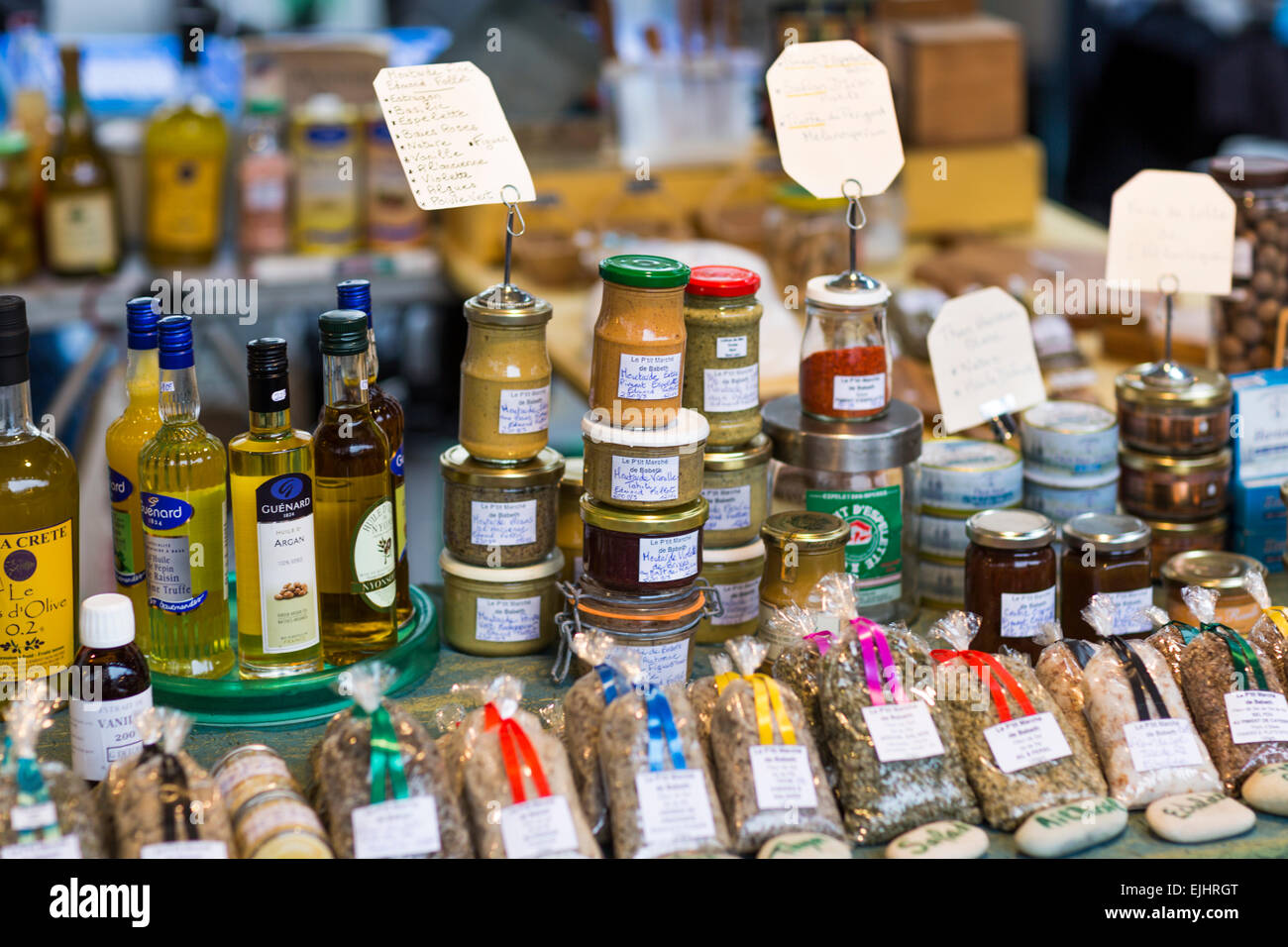 Oil, vinegar, bread and other food items on display, Paris, France - Stock Image