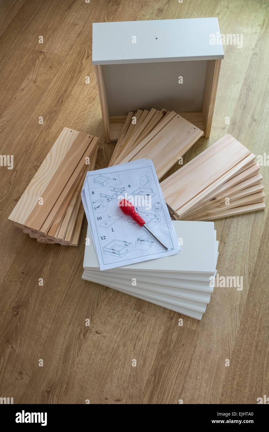 Do It Yourself drawer parts, with instructions for assembly. - Stock Image