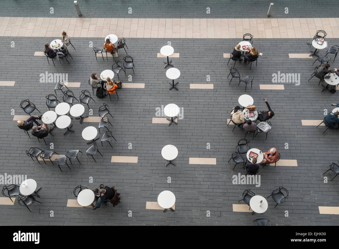 Aerial View Of People Sitting At Tables On Southbank London Viewed From Above