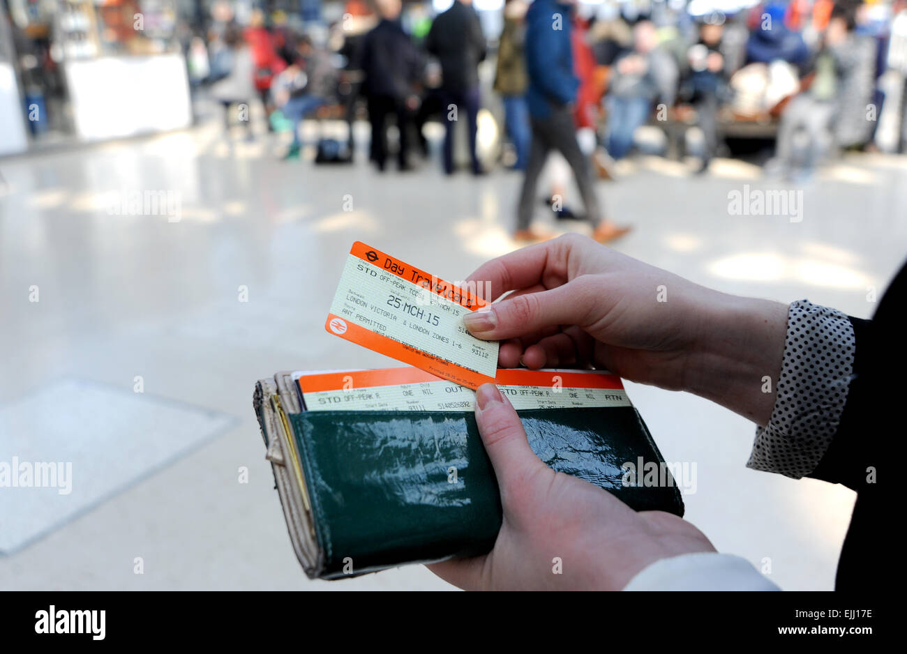 Brighton Sussex UK - Young woman with Southern rail ticket catching a train from Brighton Station to London - Stock Image
