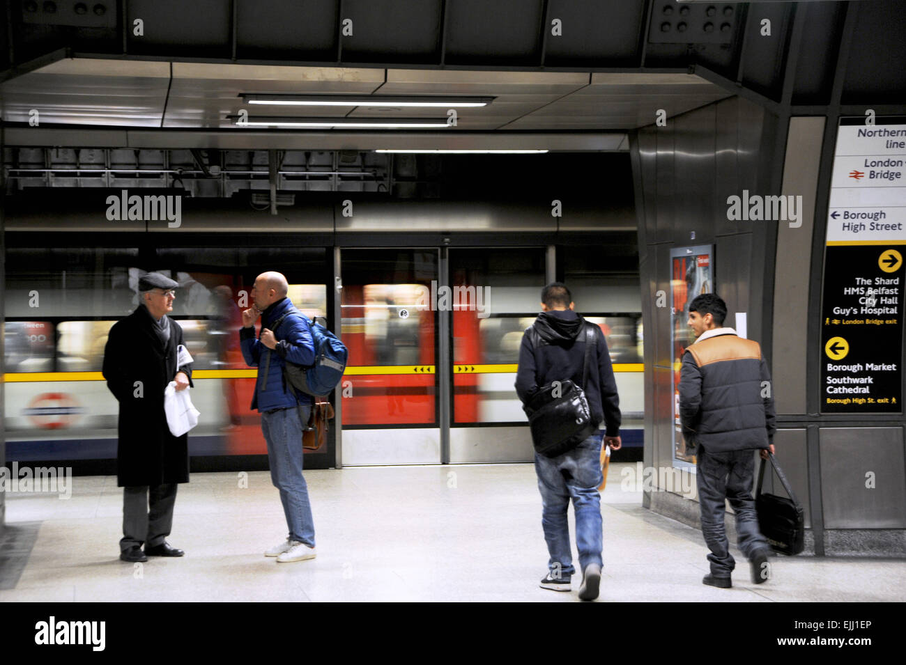London England UK - Commuters about to board a tube at London Bridge underground station on Jubilee Line Stock Photo