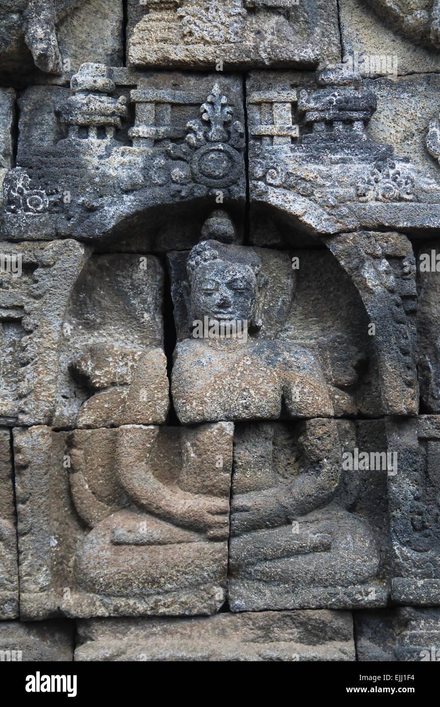 image of broken stone Indian /Indonesian deity - Stock Image