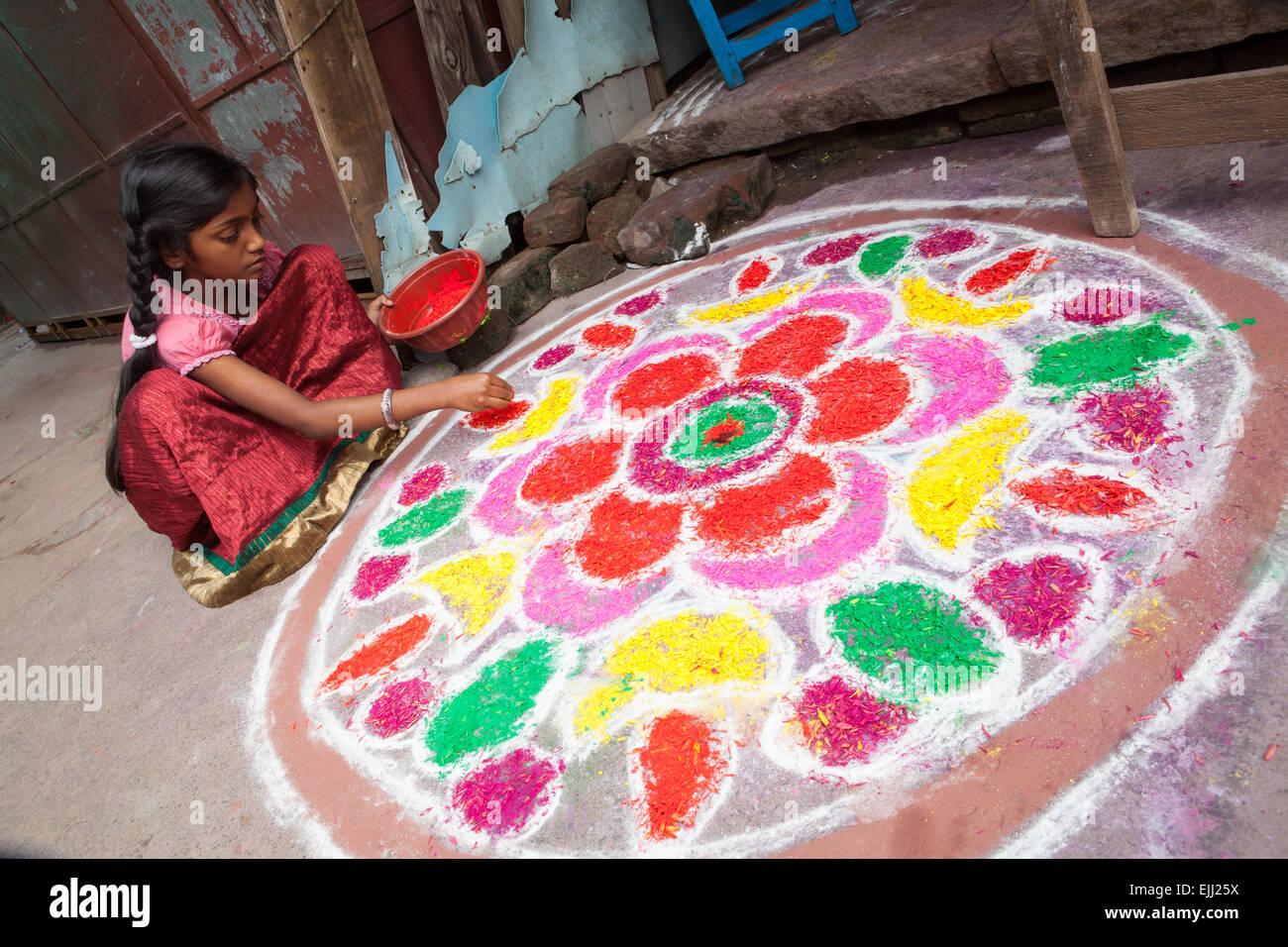 Girl making a Rangoli to celebrate the Pongal festival Stock Photo