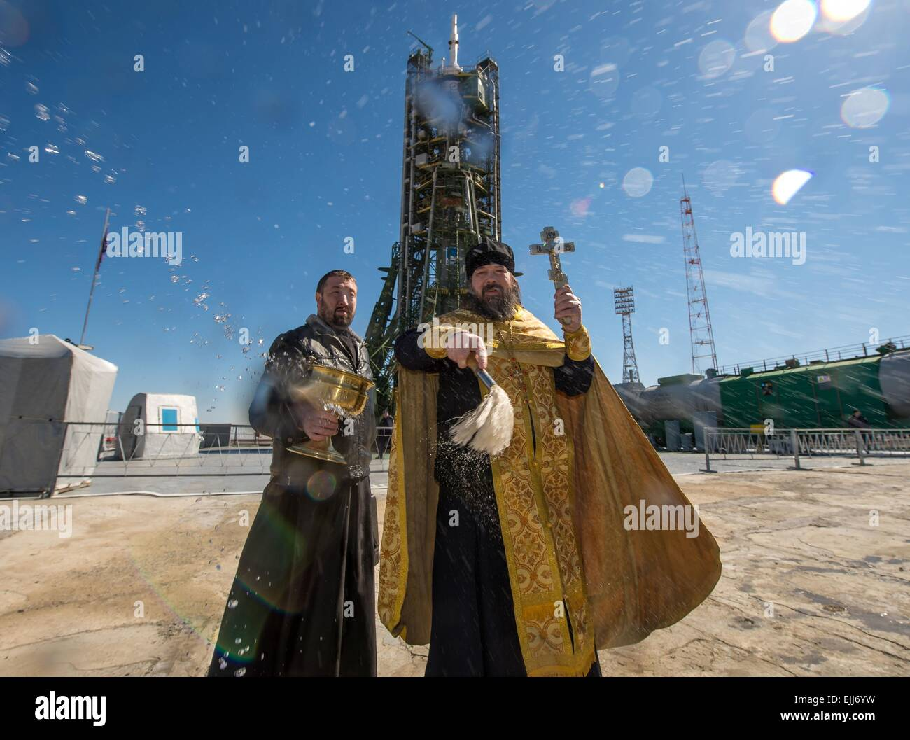 Baikonur, Kazakhstan. 26th Mar, 2015. A Russian Orthodox priest blesses the Soyuz rocket and media on the launch Stock Photo
