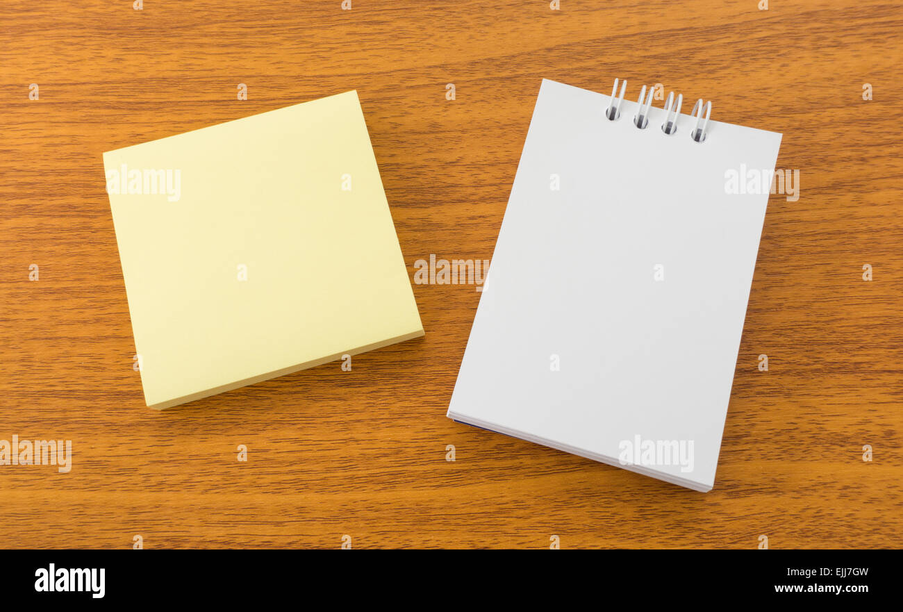 White Memo Note and Sticky Postit on Brown Wooden Surface - Stock Image