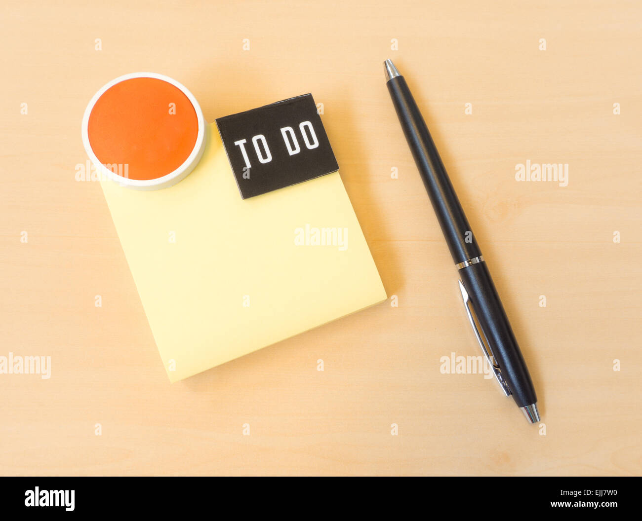 To do List Yellow Postit with Smile Icon and Black Pen on Wood Texture - Stock Image