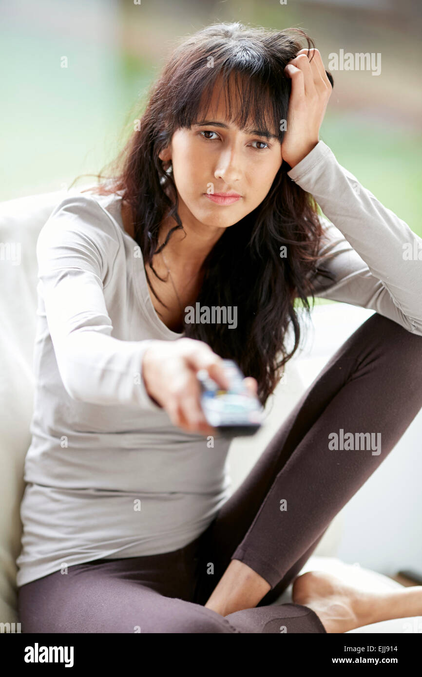 Bore teenager with tv remote - Stock Image