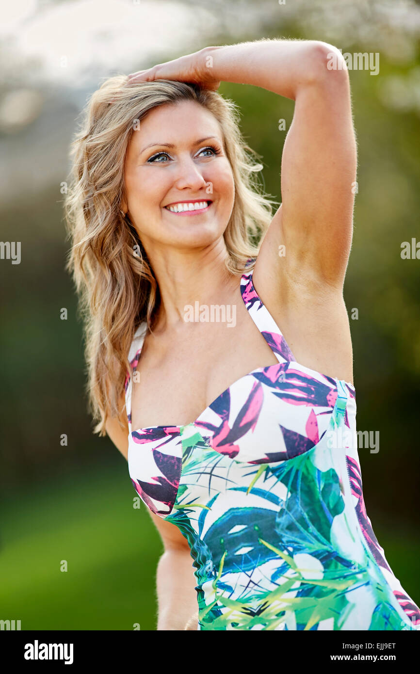 Portrait of pretty woman outdoors - Stock Image