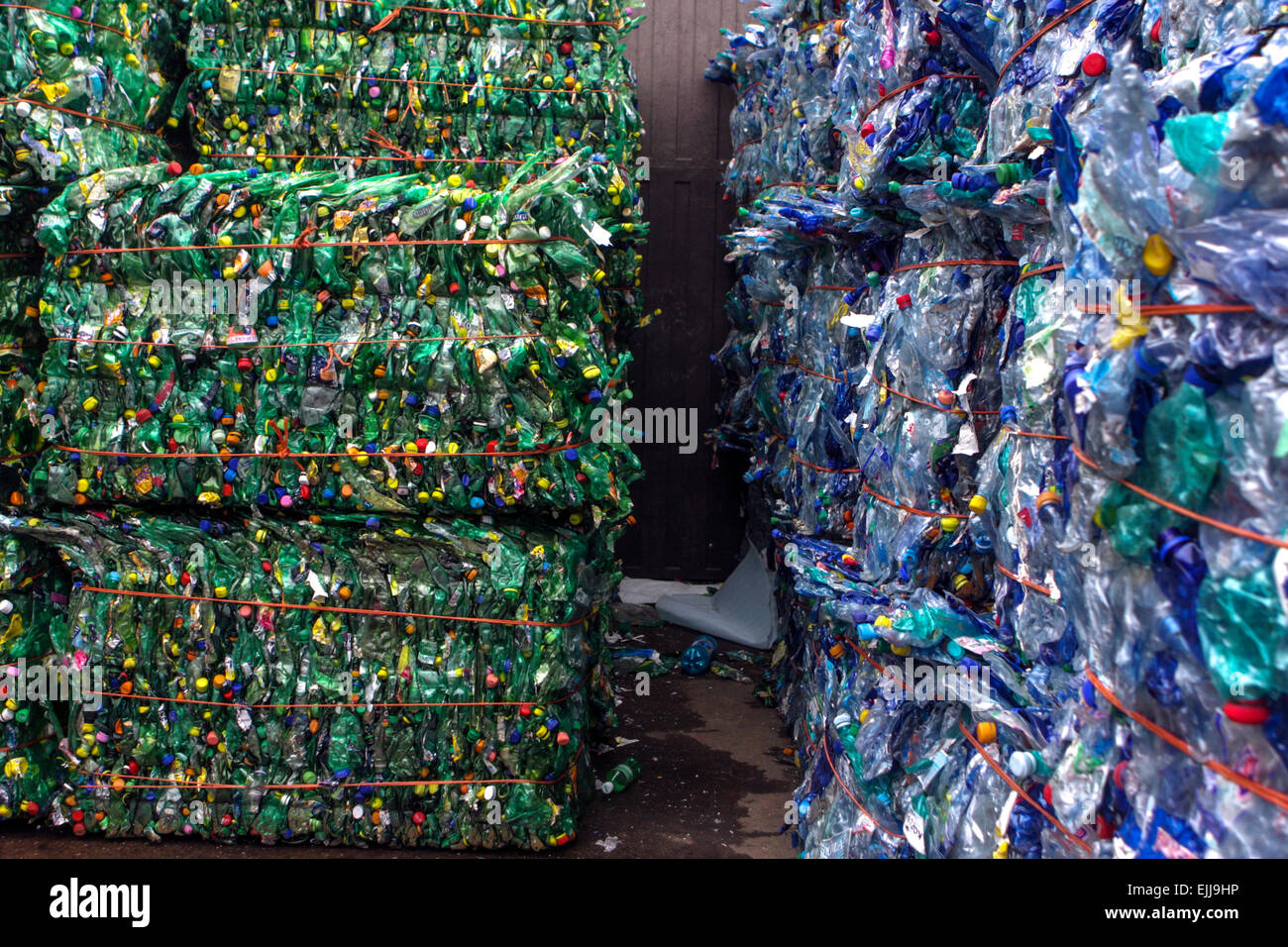 Flattened plastic bottles for recycling - Stock Image