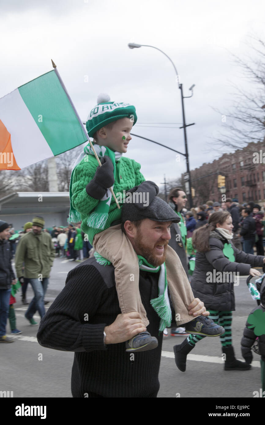 Irish American dad and son at the St. Patrick's Day Parade in Park Slope, Brooklyn, NY. - Stock Image