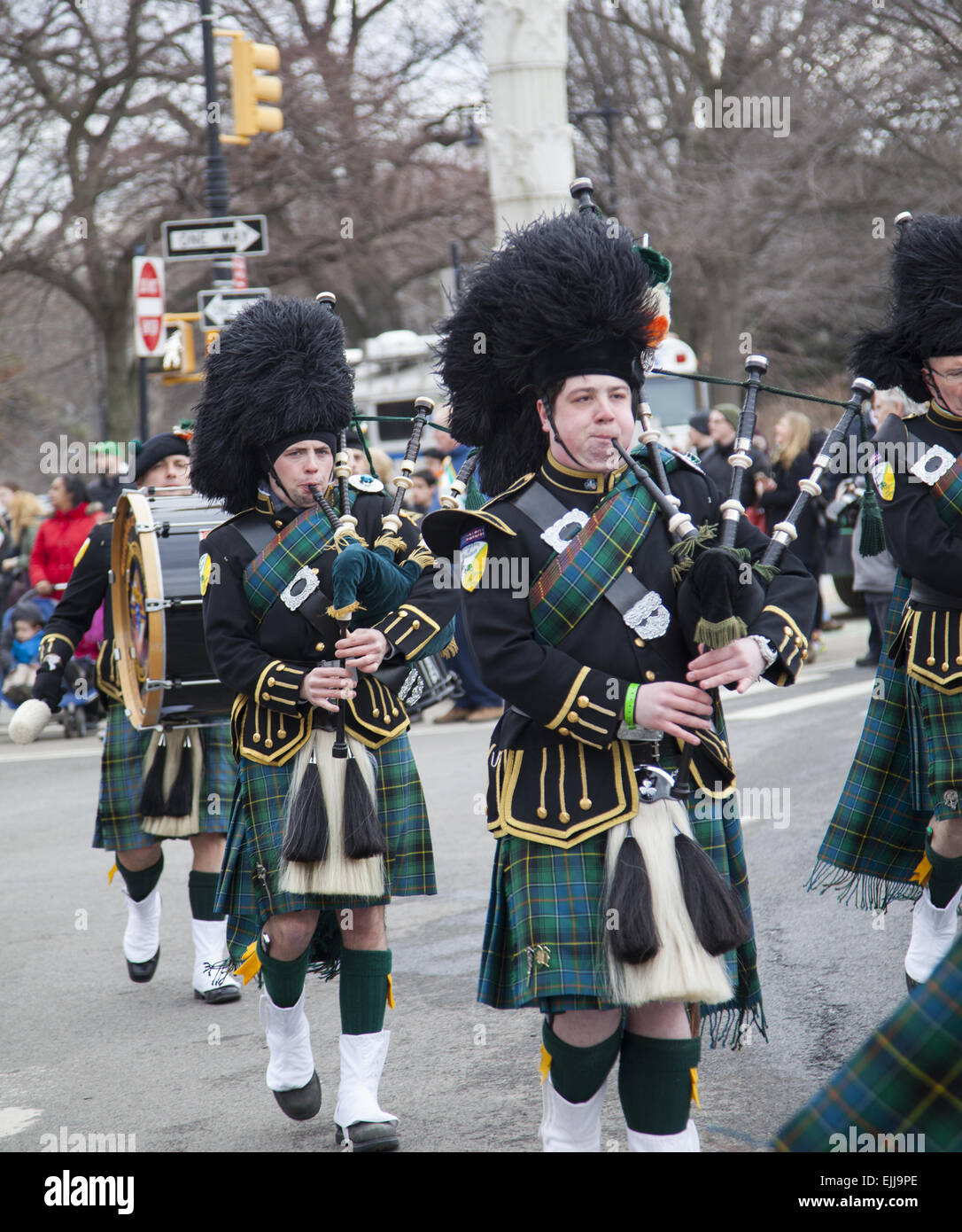 Bagpipers in full regalia march in the  St. Patrick's Day Parade in Park Slope, Brooklyn, New York - Stock Image