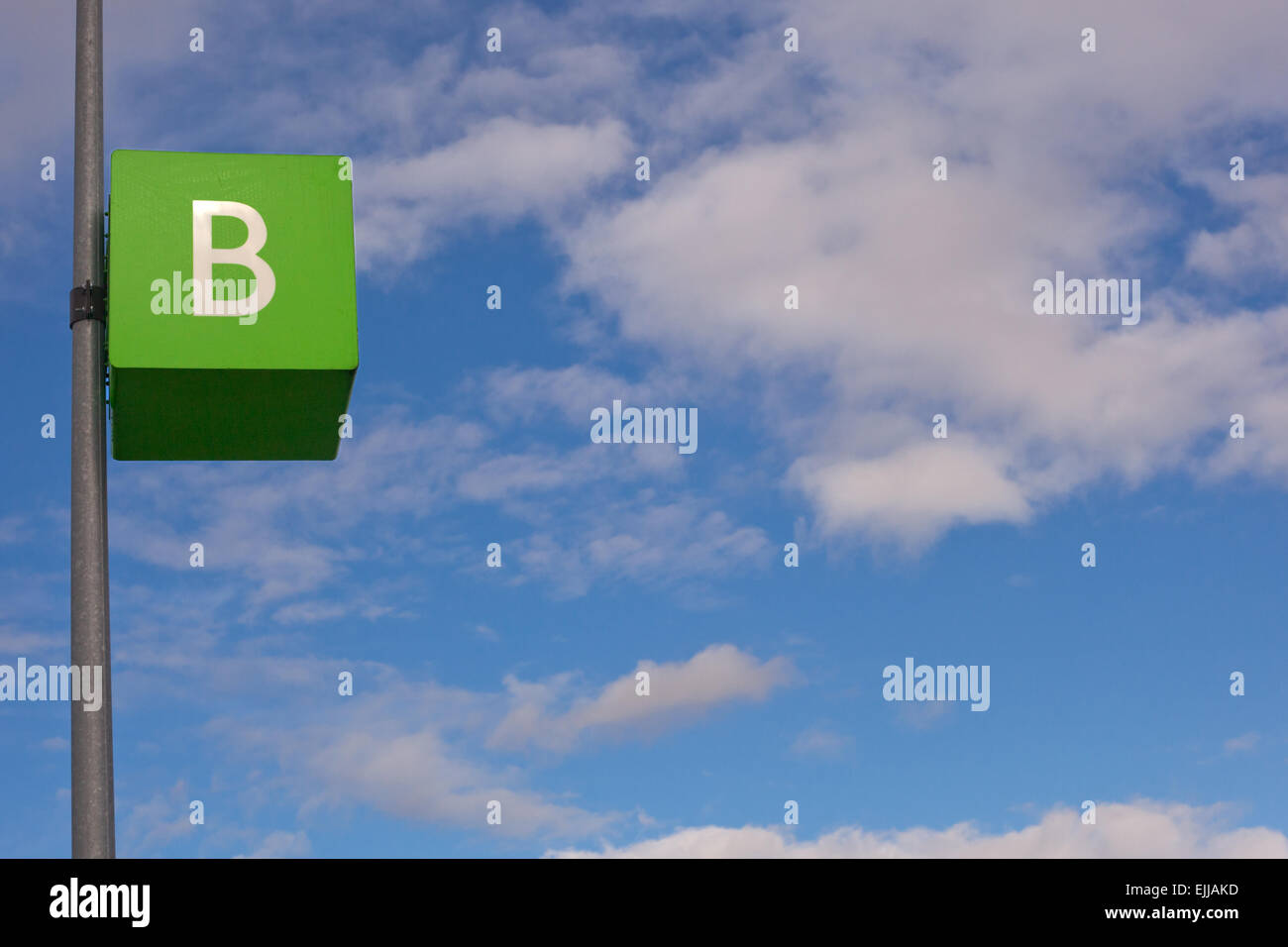 Parking signal pole of letter B area over blue cloudy sky Stock Photo