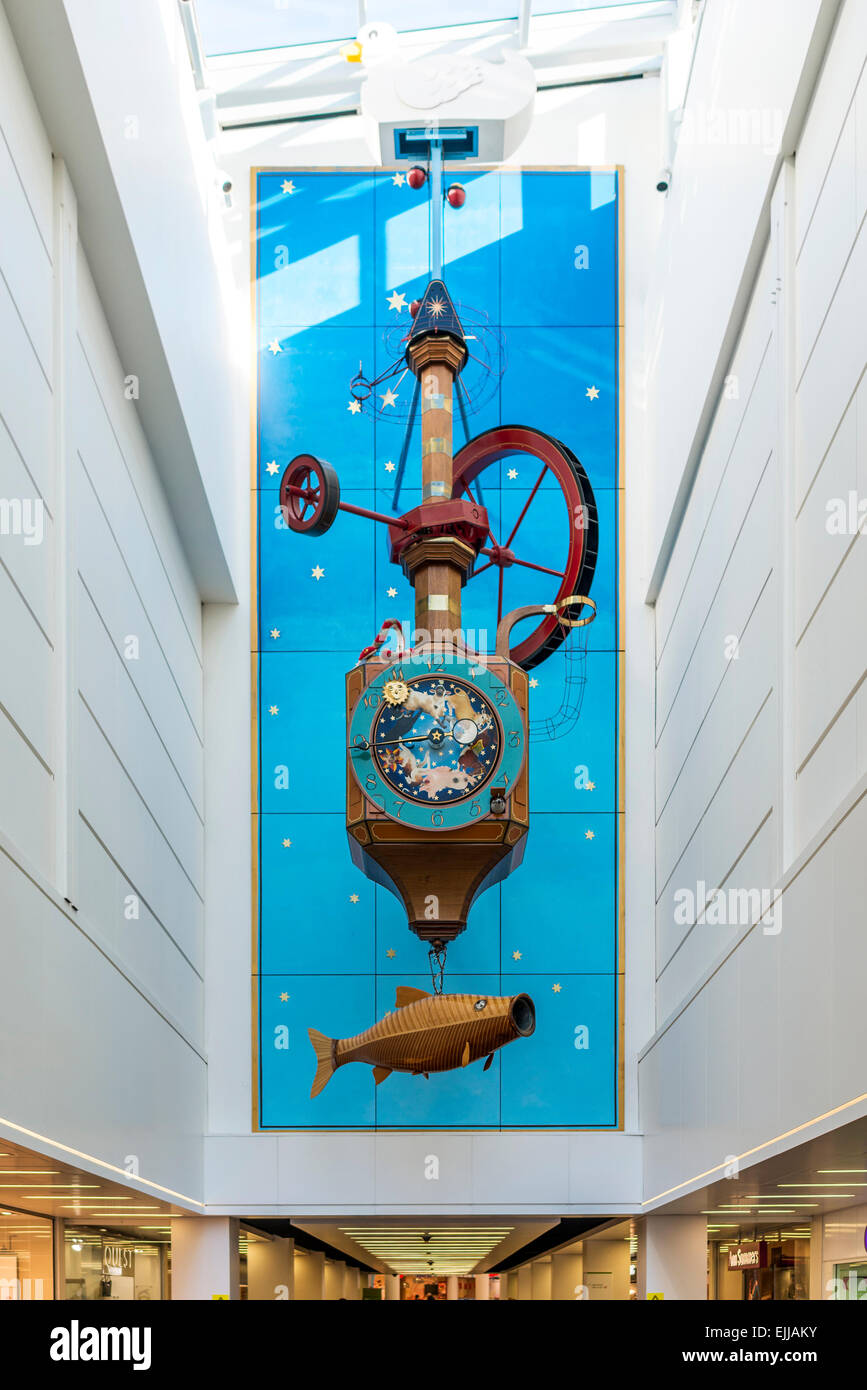 The Wishing Fish Clock is a mechanical clock in Cheltenham's Regent Arcade designed by Cotswold artist Kit Williams - Stock Image