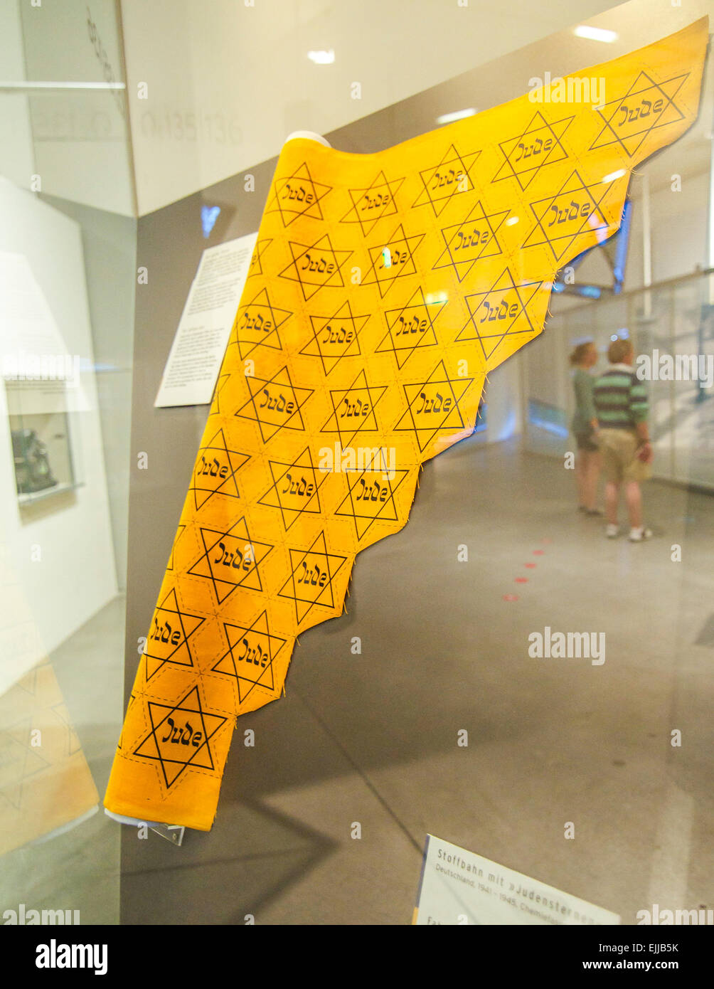 Roll of uncut yellow stars indicating that the wearer was Jewish during the Third Reich era of World War II in Europe. - Stock Image