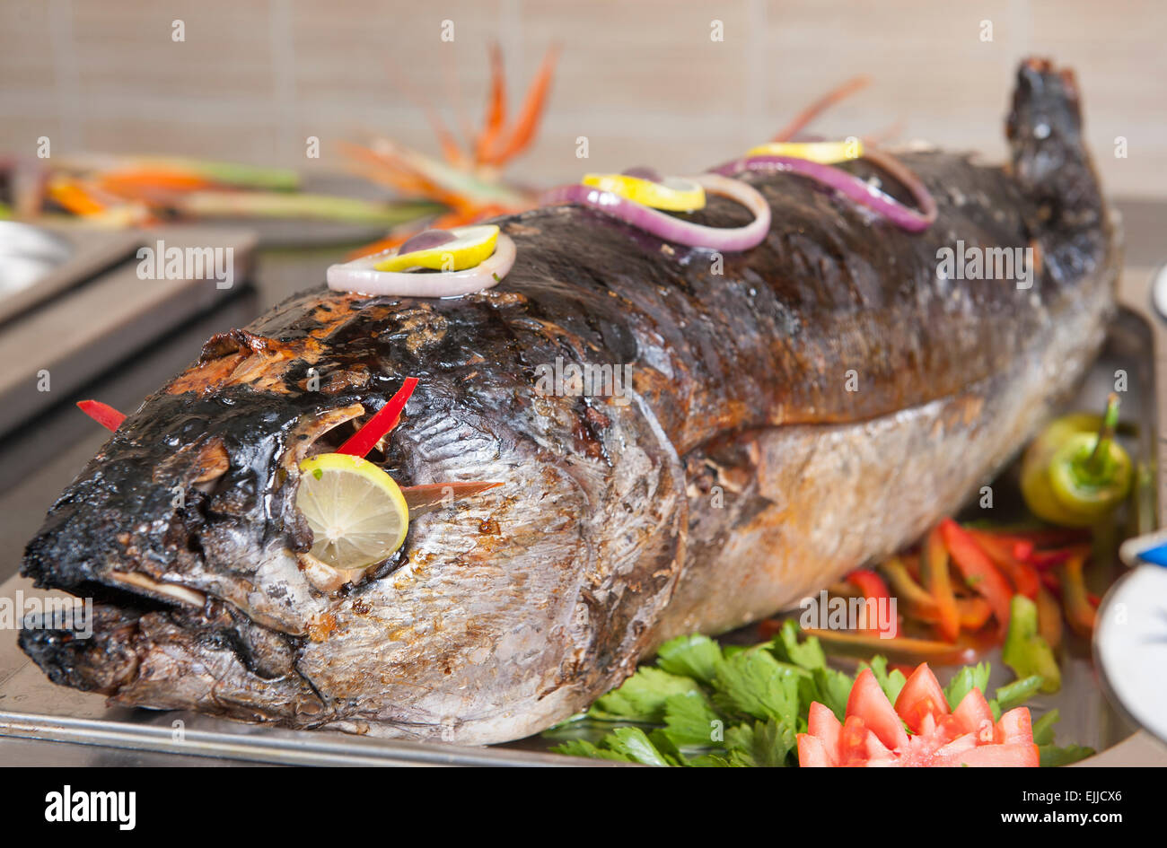 Whole Grilled Salmon Fish With Salad At A Hotel Restaurant